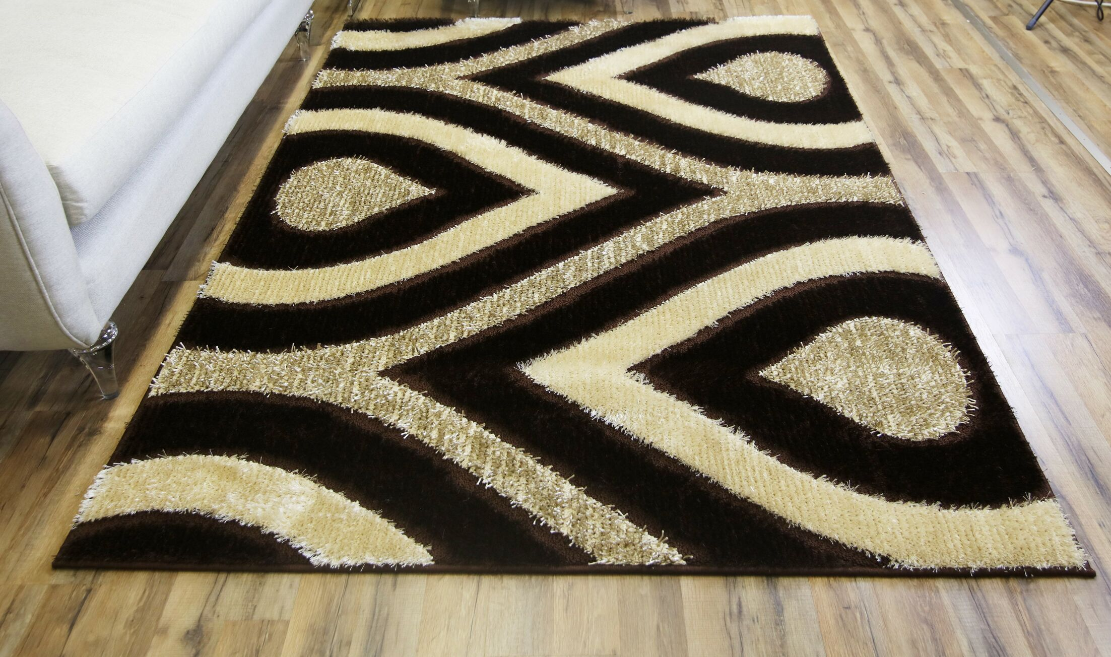 Gloria Brown Area Rug Rug Size: 7'10