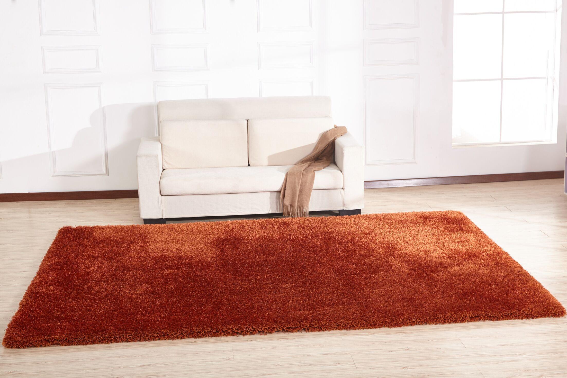 Heineman Solid Shag Hand-Tufted Orange Area Rug Rug Size: Rectangle 7'6