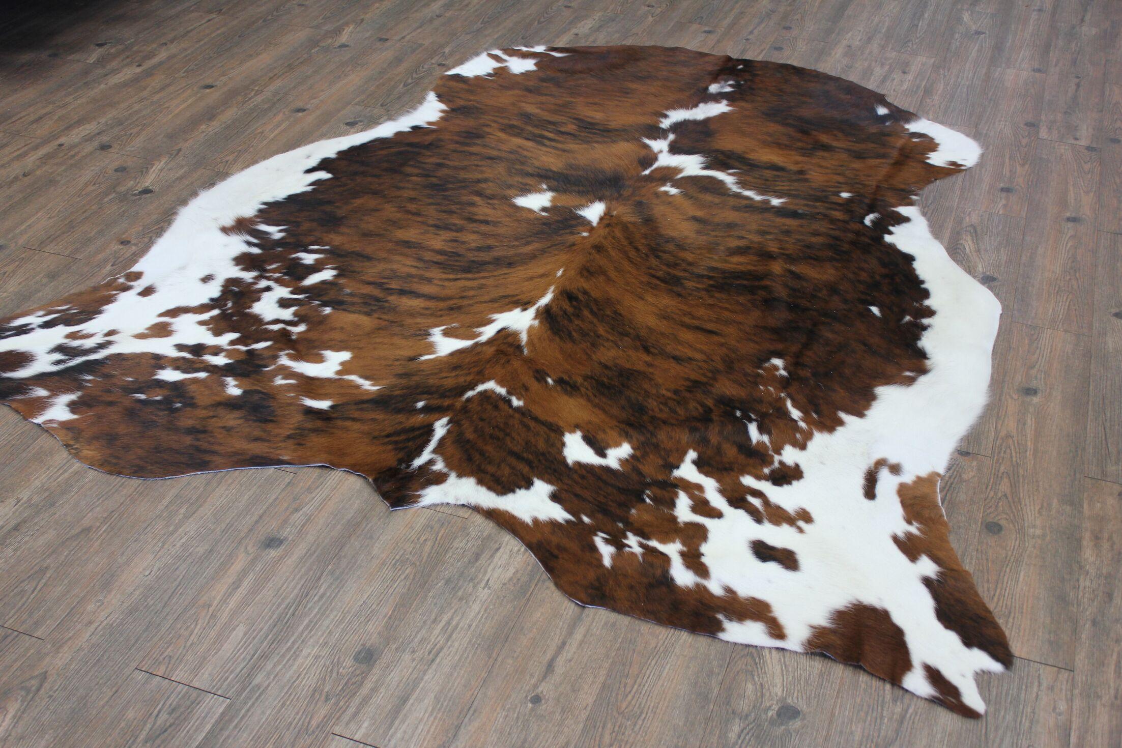 Thurso Hand-Woven Cowhide Brown Area Rug
