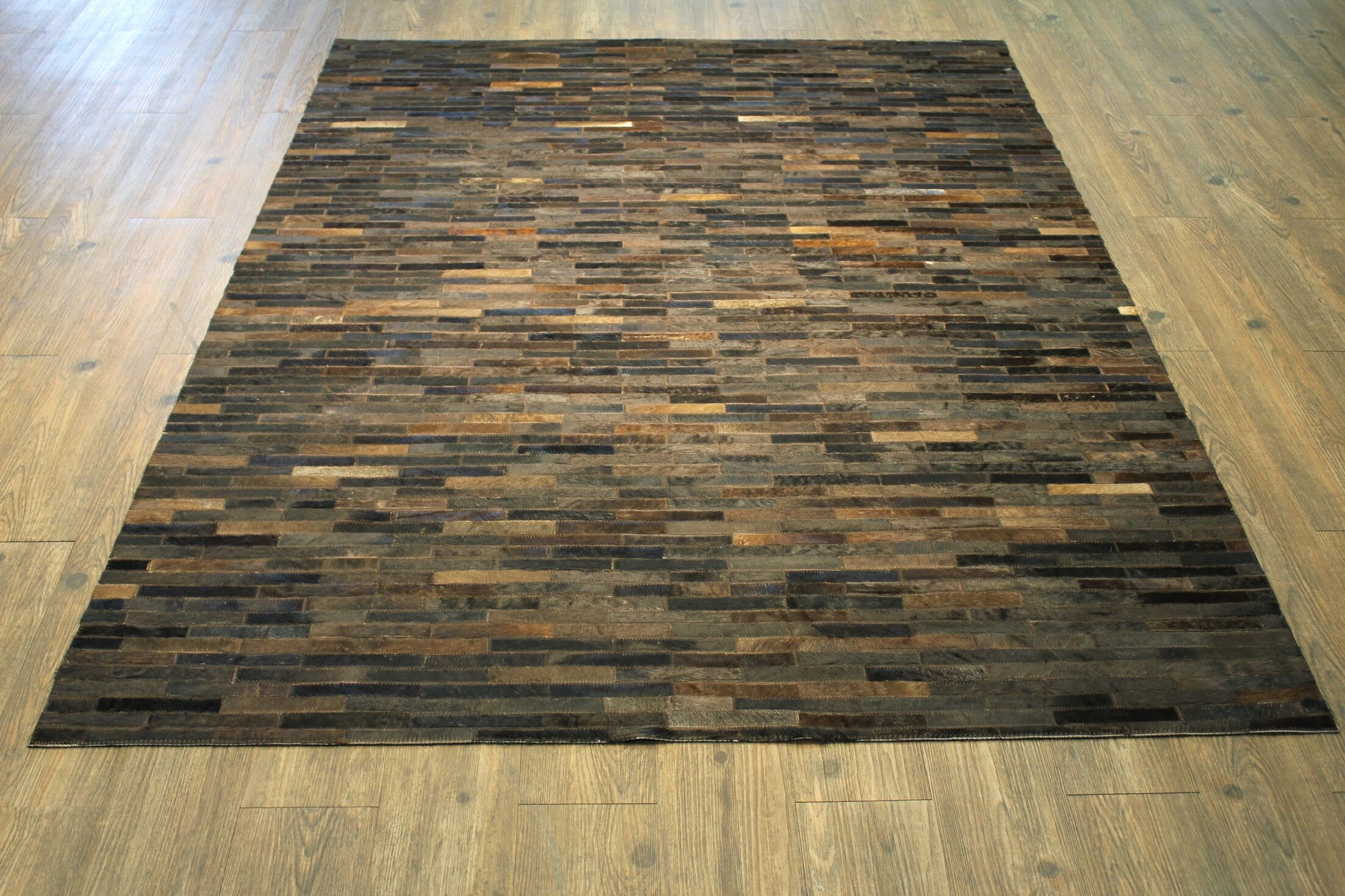 Peters Handmade Cola Brown Area Rug Rug Size: Rectangle 5' x 7'
