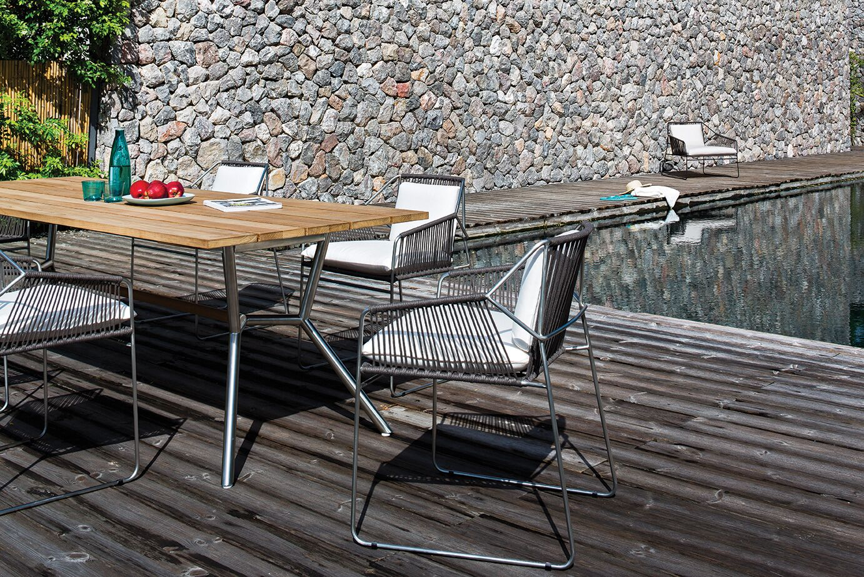 Reef 180 Aluminum Dining Table� Top Finish: Nordic Black HPL, Base Finish: Stainl. St. Cross Bar