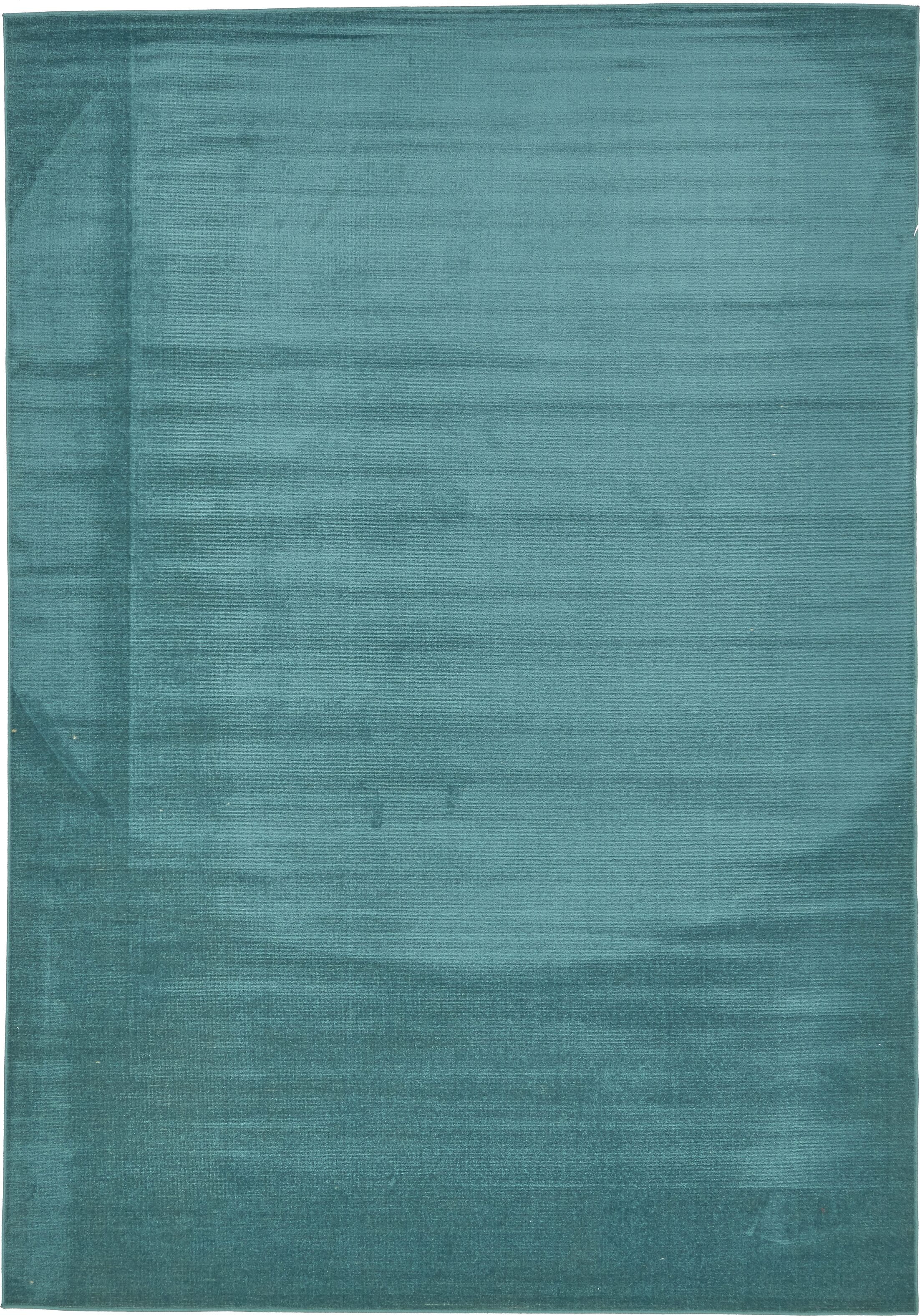 Whether you're looking to tie together your space or add a pop of color to a neutral-hued ensemble, this lovely rug can do it all. Featuring a vibrant teal hue, it is woven of polypropylene with a low pile design. Try setting it under a tufted chaise ...