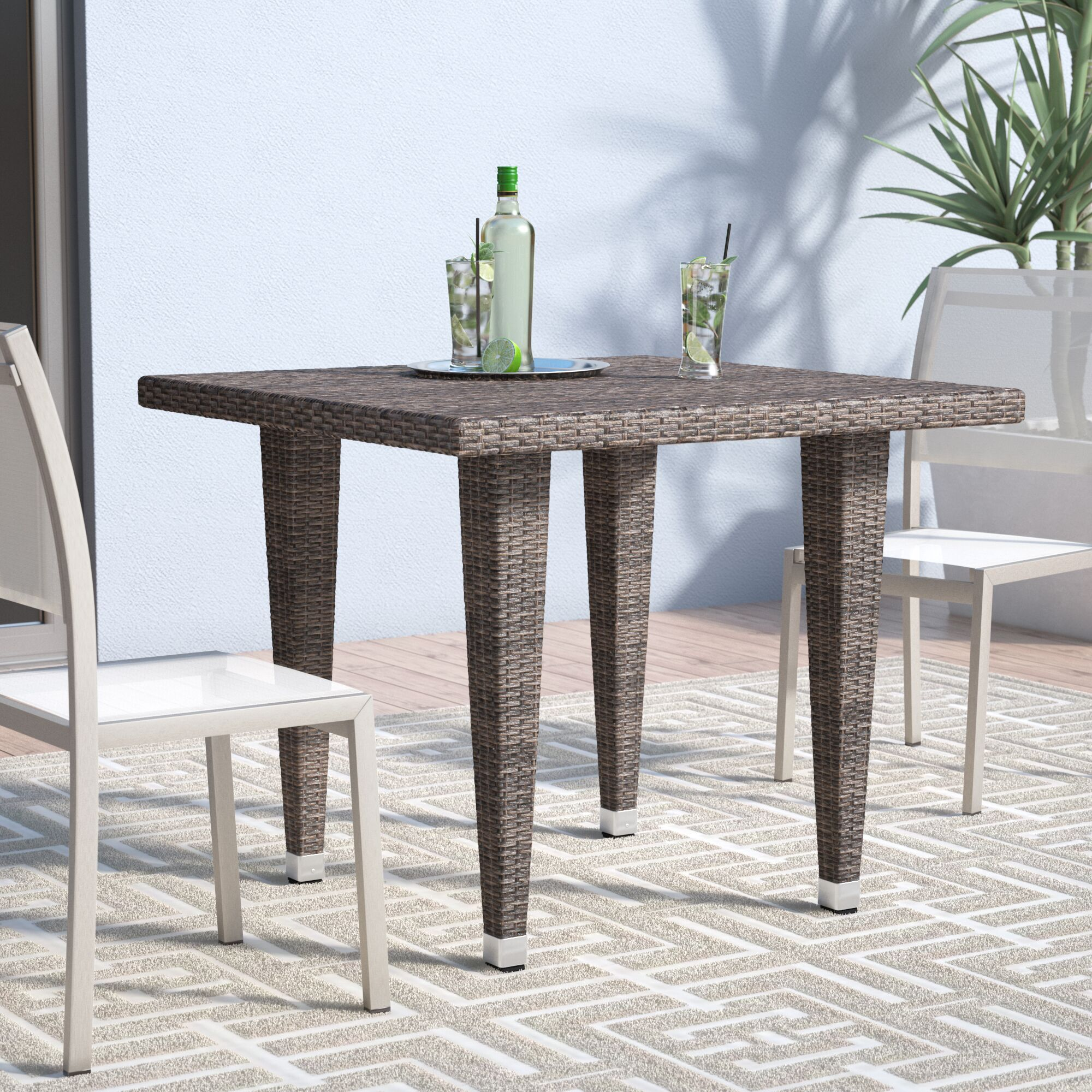 Weishaar Outdoor Wicker Dining Table Color: Mix Mocha