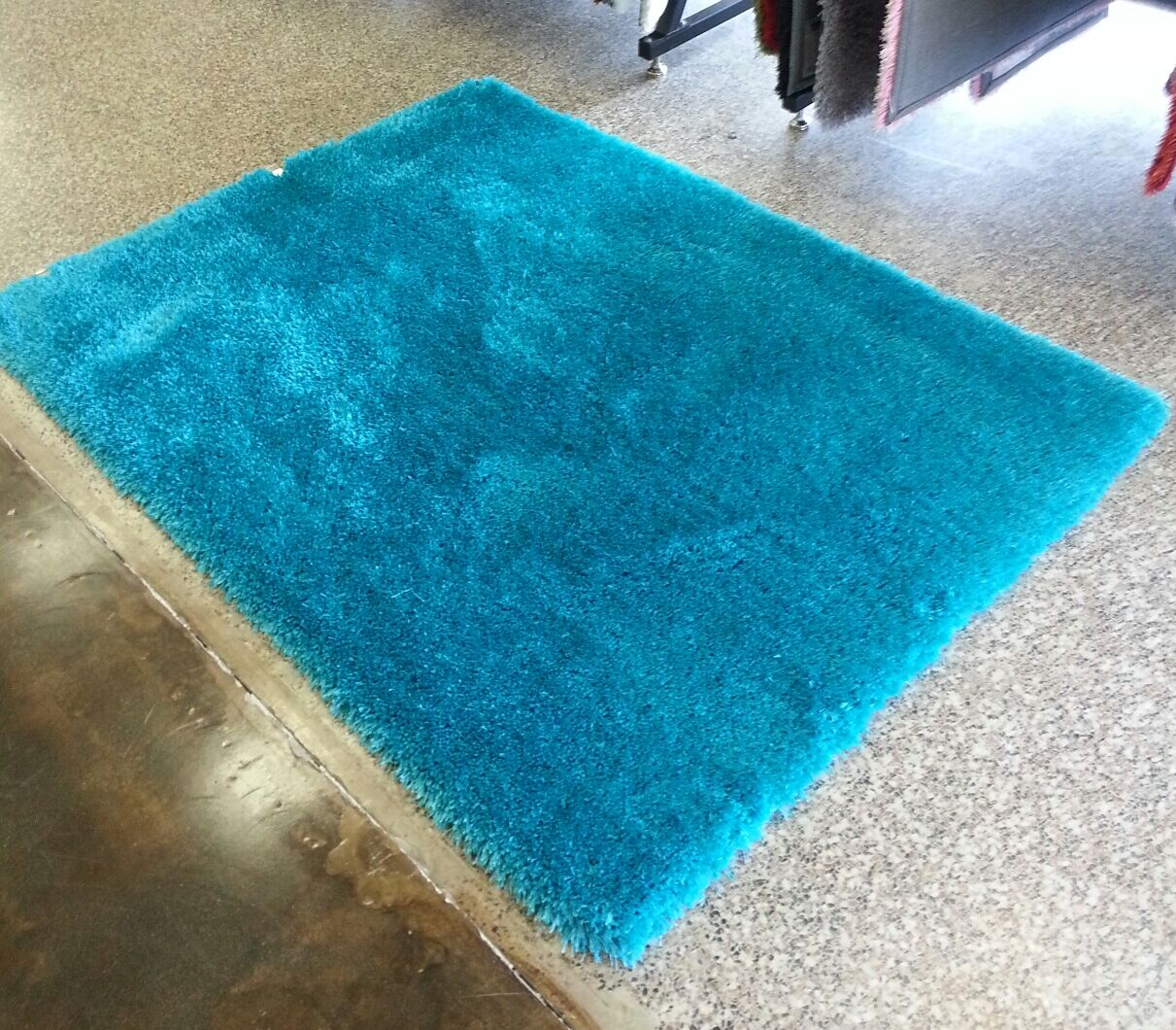 Heineman Solid Shag Hand-Tufted Turquoise Area Rug Rug Size: Rectangle 7'6