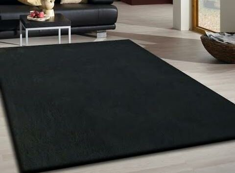 Heineman Solid Shag Hand-Tufted Black Area Rug Rug Size: Rectangle 5' x 7'