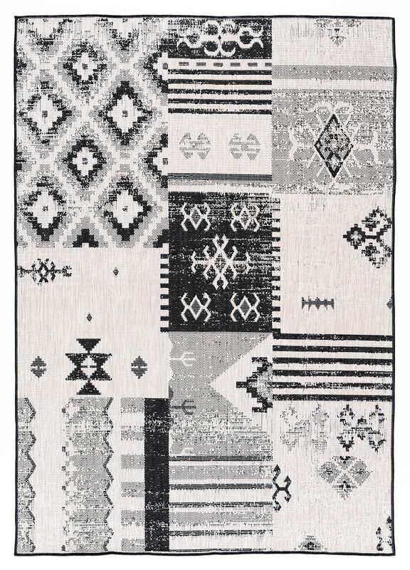 Tseng Reversible Black/White Indoor/Outdoor Area Rug Rug Size: Rectangle 7'10