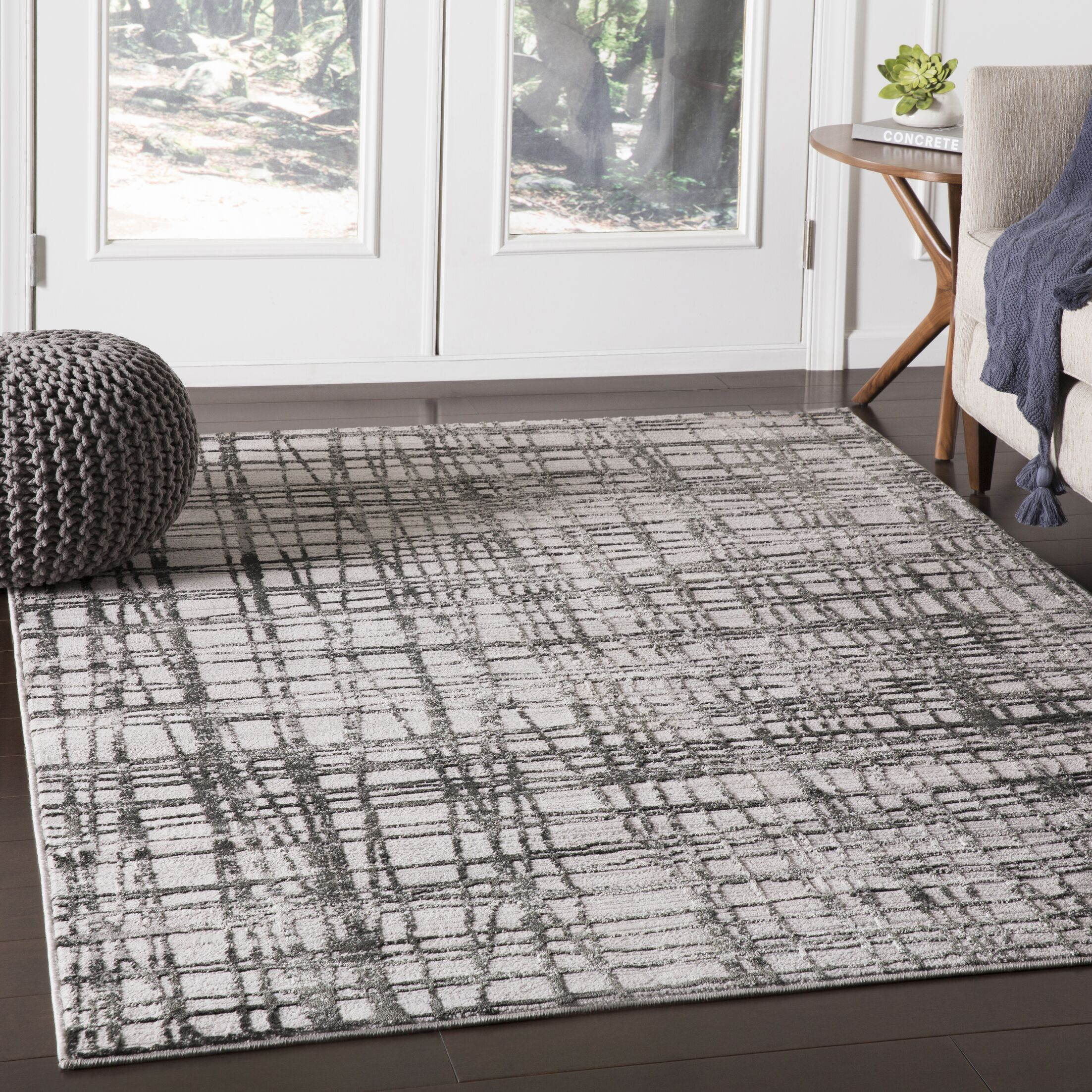 Ginder Abstract Black Area Rug Rug Size: Rectangle 7'10