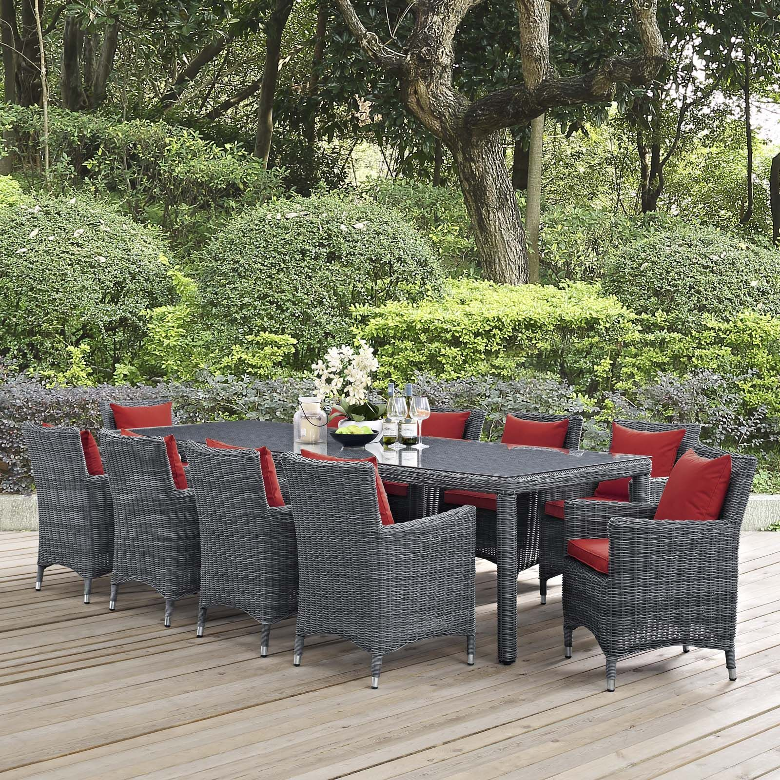 Alaia 11 Piece Rattan Sunbrella Dining Set with Cushions Cushion Color: Red