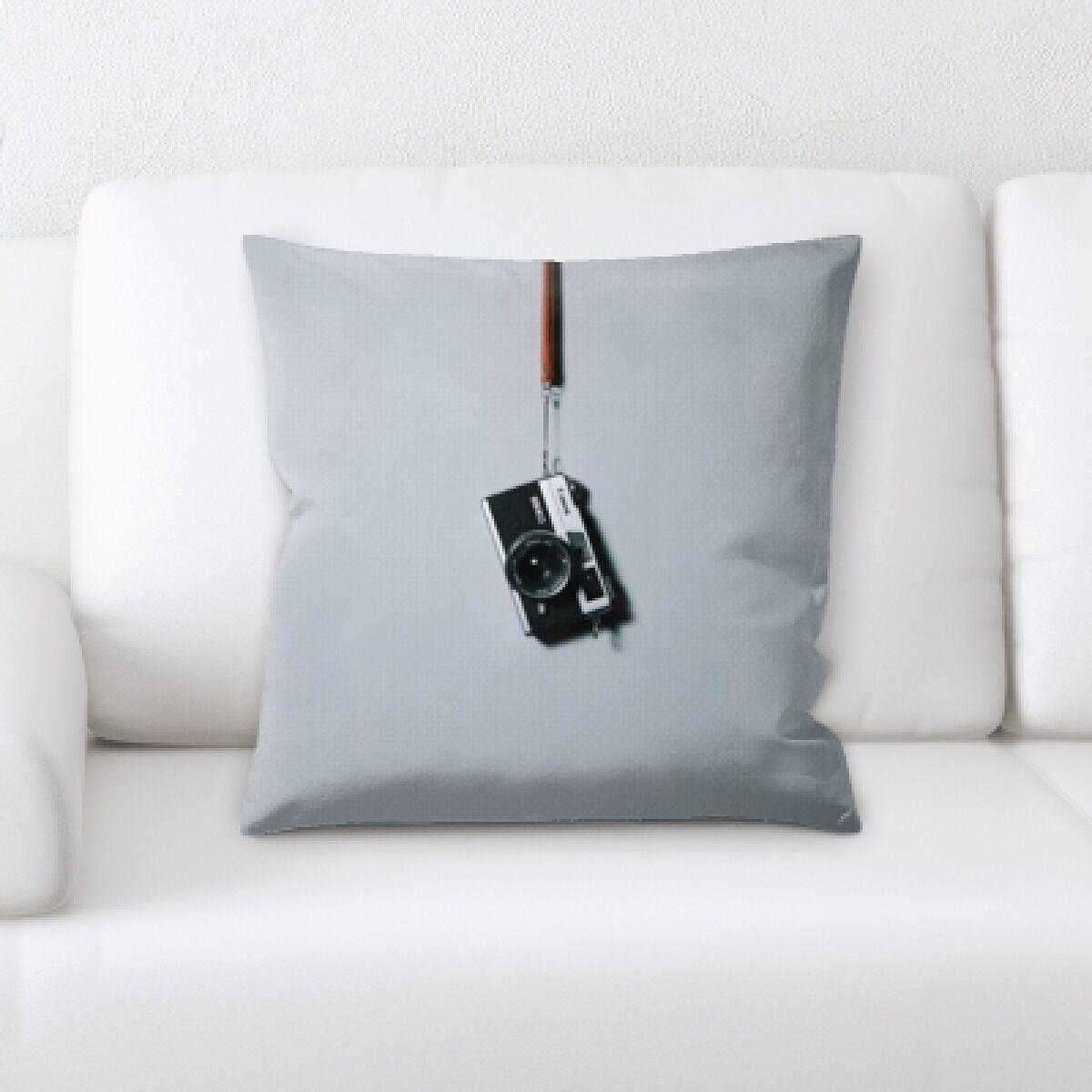 Minton Hanging Camera Throw Pillow