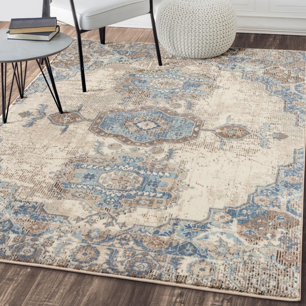 Keturah Distressed Oriental Ivory/Blue Area Rug Rug Size: Rectangle5' x 7'