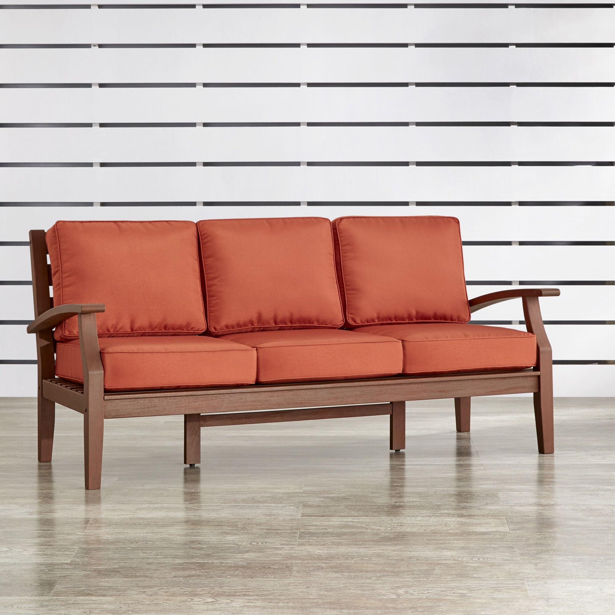 Brook Hollow Sofa with Cushion Fabric: Red, Finish: Brown