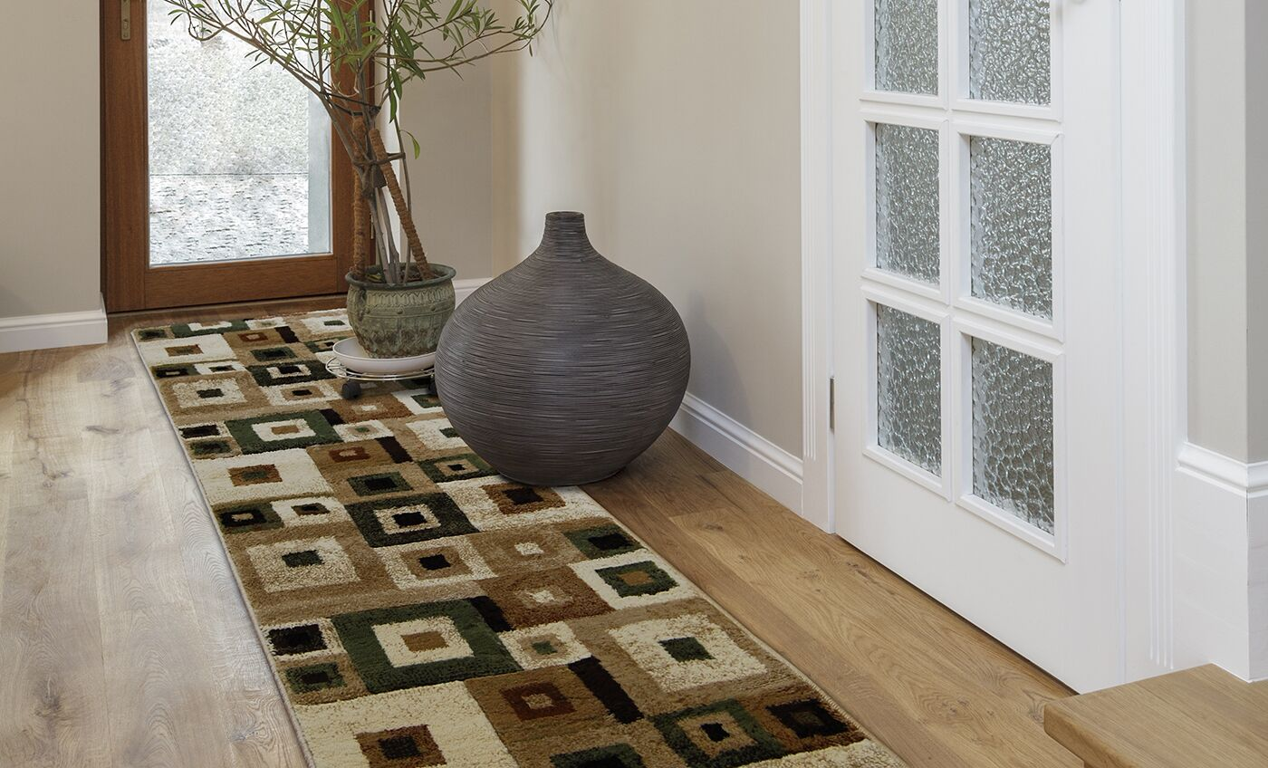 Nolan Brown/Green Area Rug Rug Size: 8' x 10'