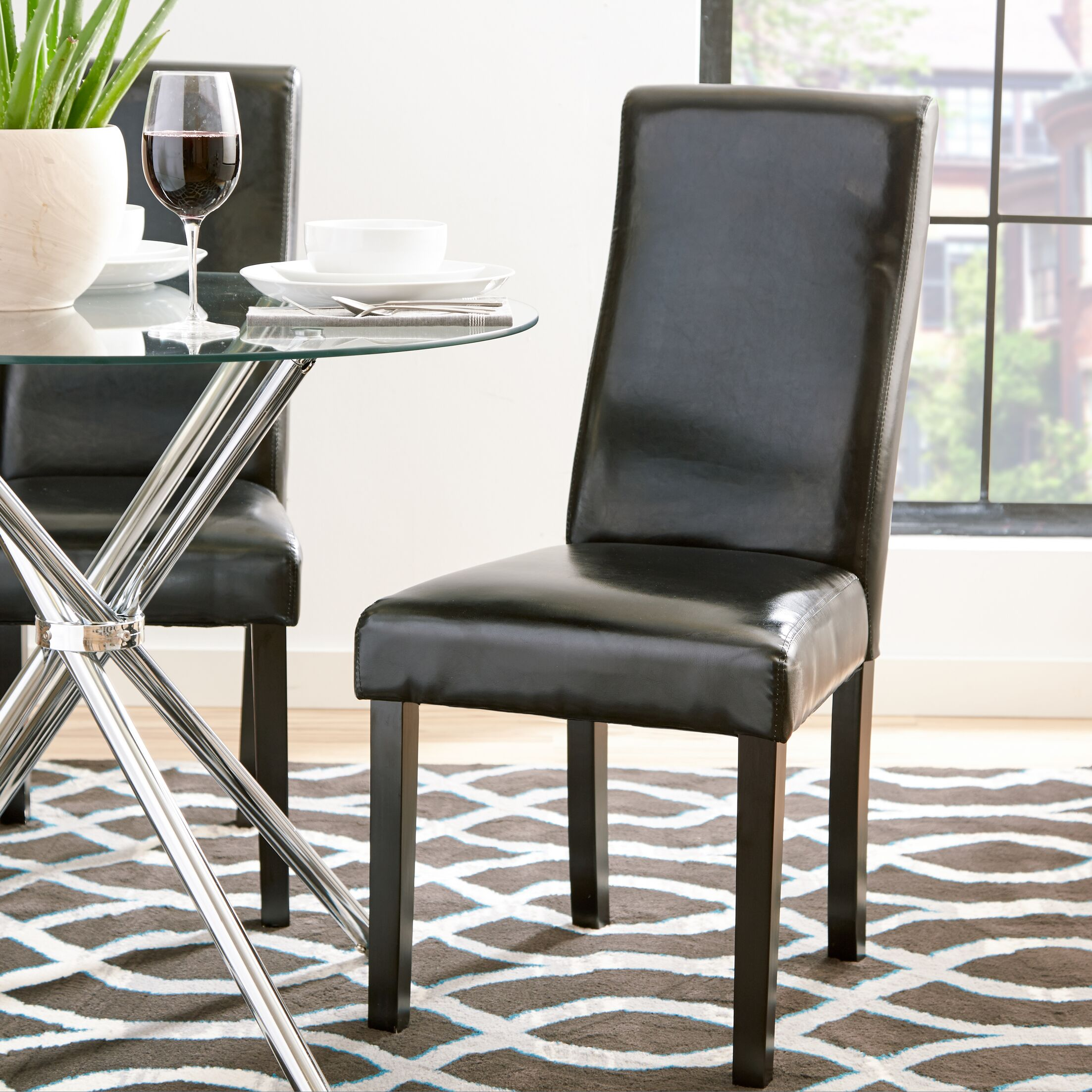Jodie Curved-Back Dining Chair Upholstery: Black Faux Leather