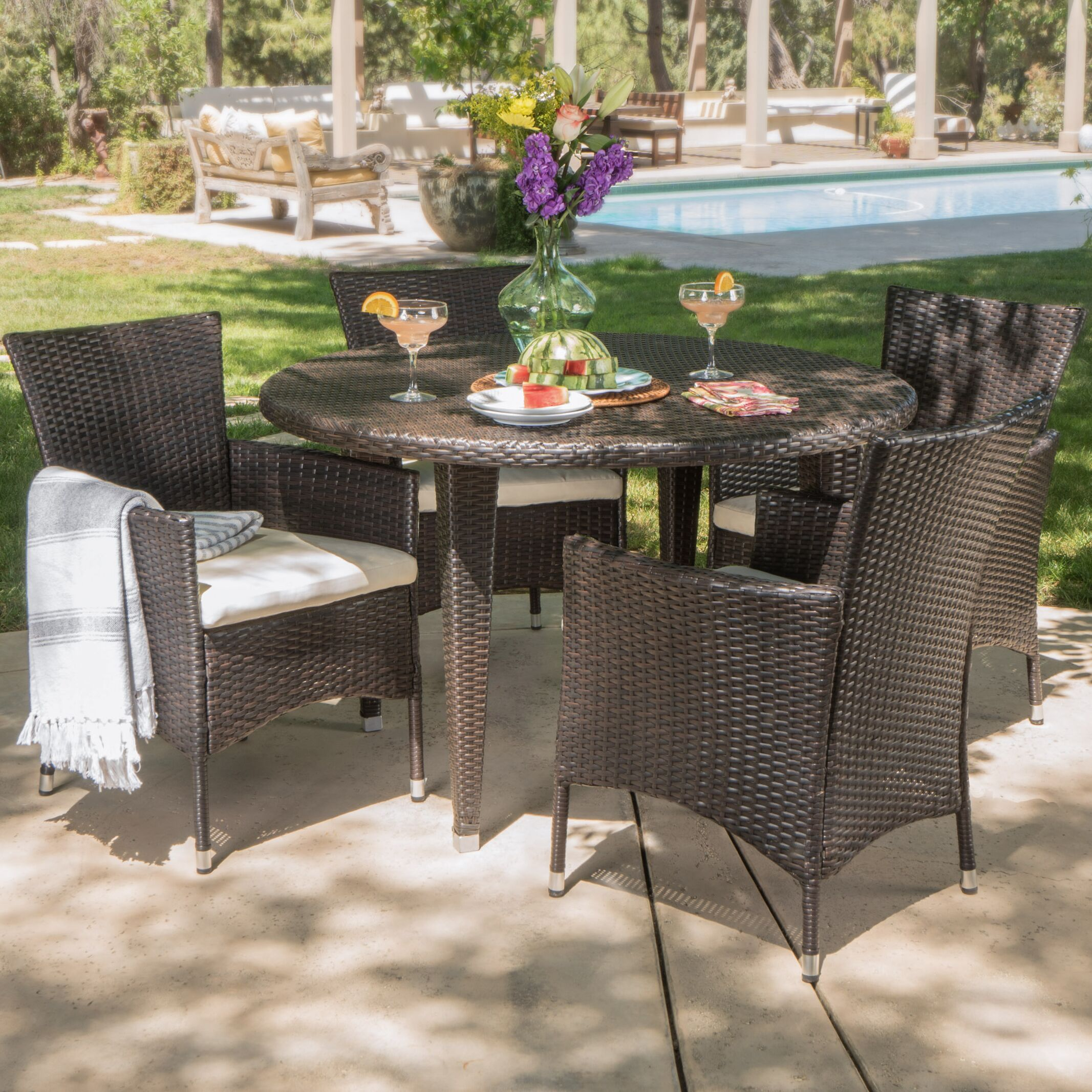 Dionisio 5 Piece Dining Set with Cushions Color: Brown