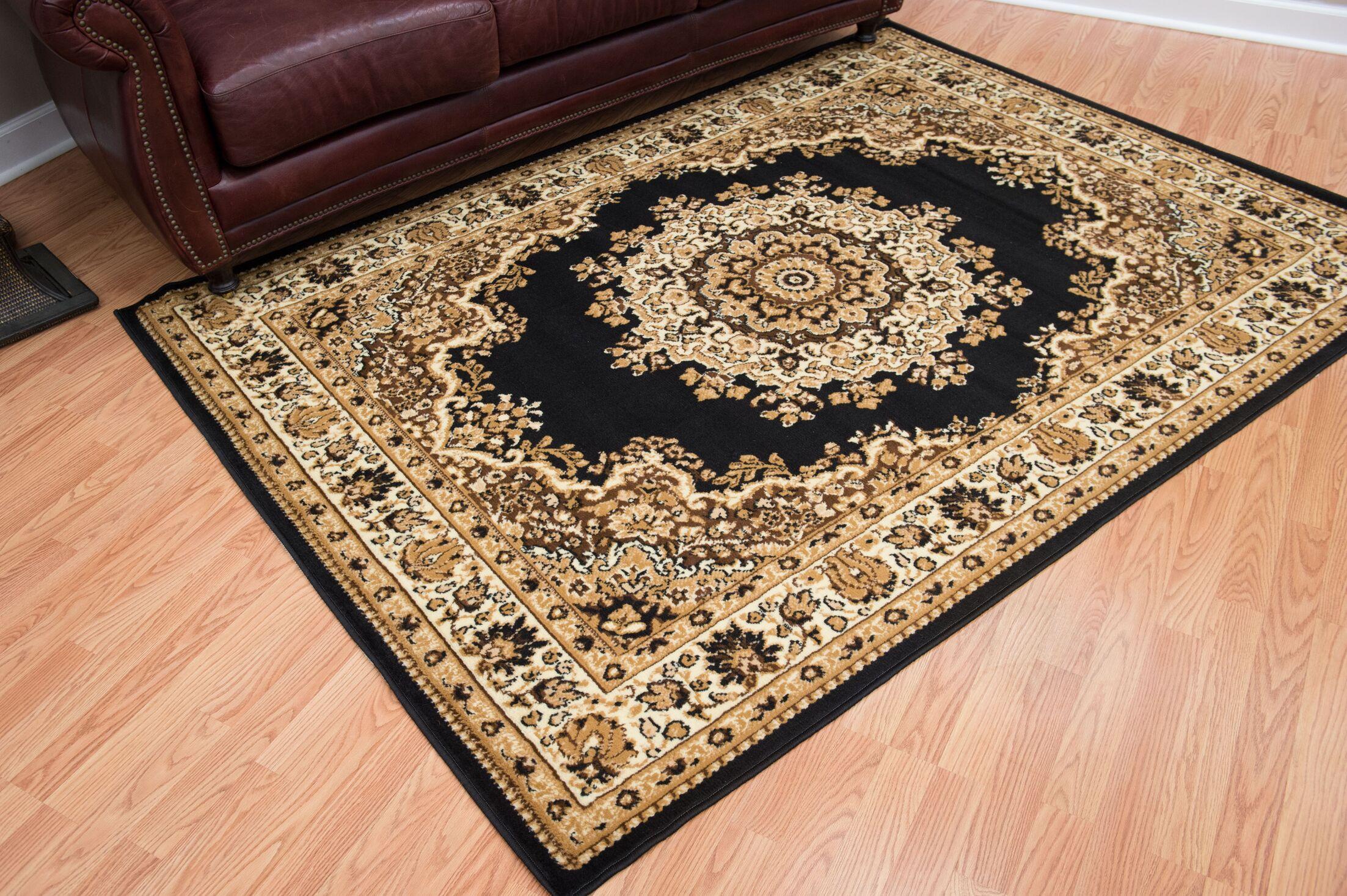 Dallas Floral Kirman Black Area Rug Rug Size: 5'3