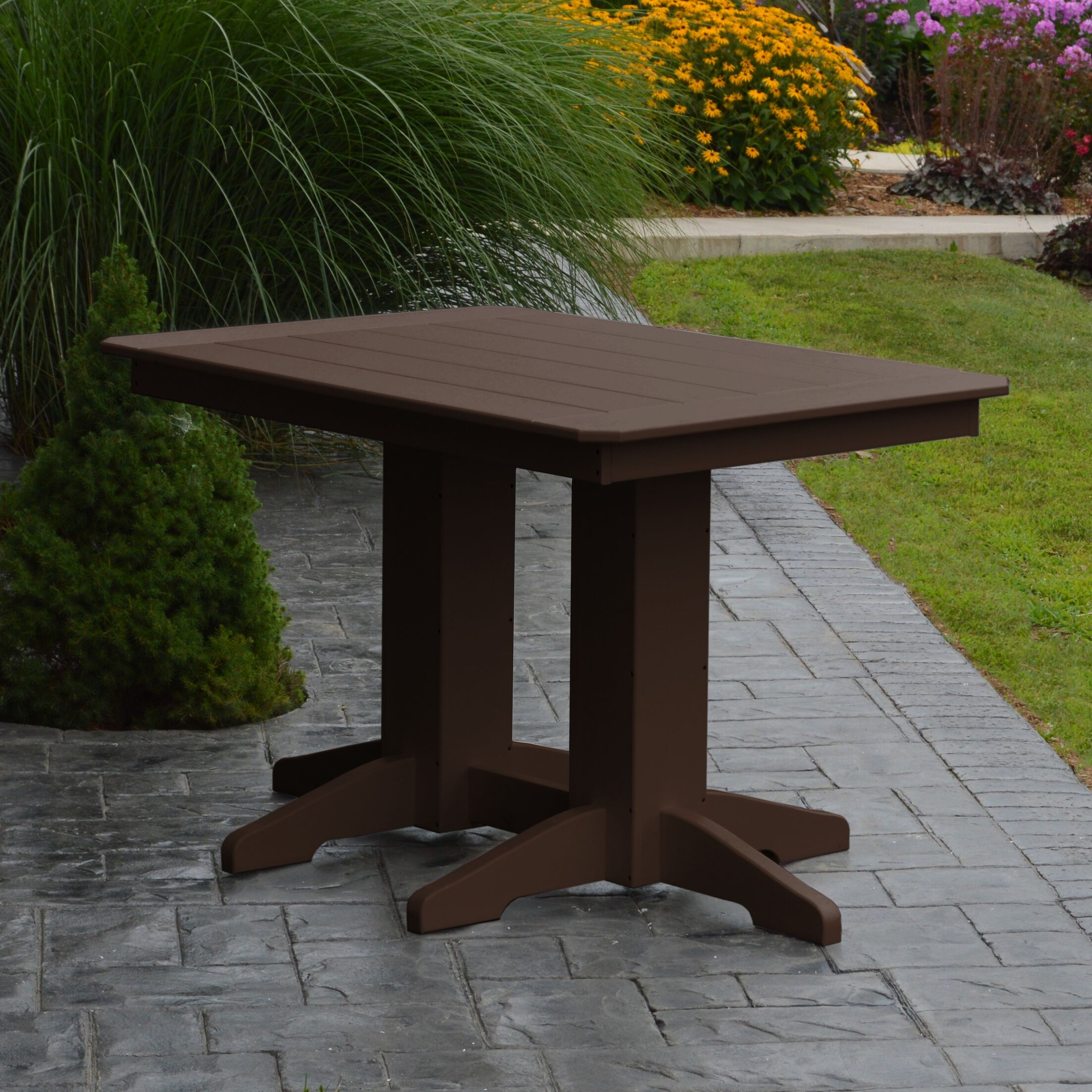 Nettie Dining Table Color: Tudor Brown, Table Size: 60