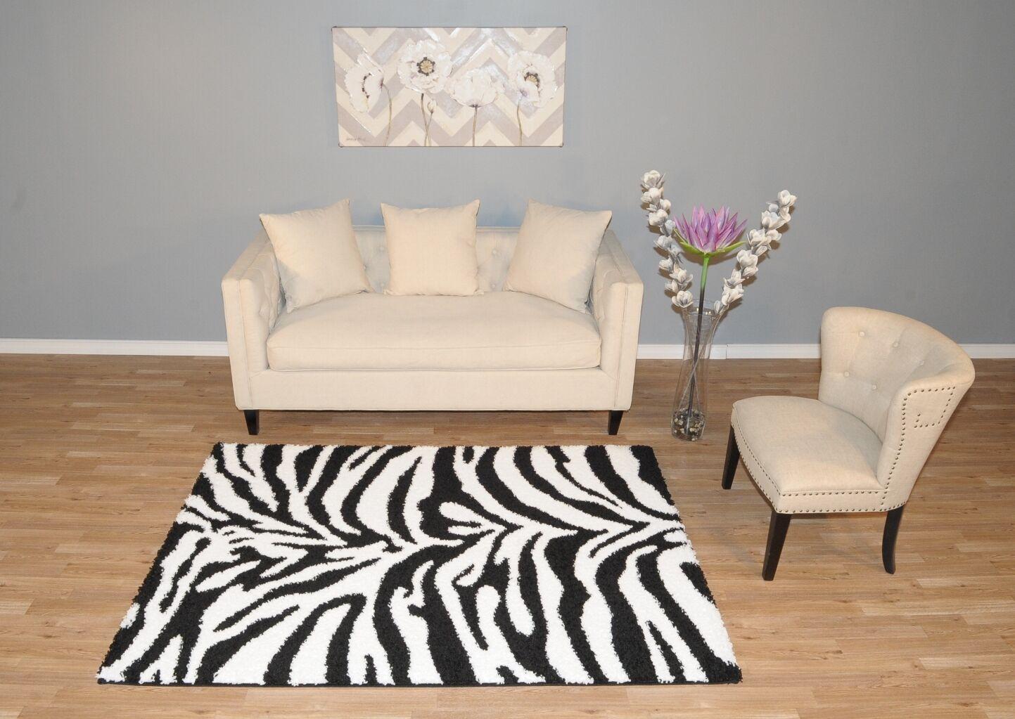 Burns Zebra Print Black/Snow White Shag Area Rug Rug Size: Rectangle 5' x 7'
