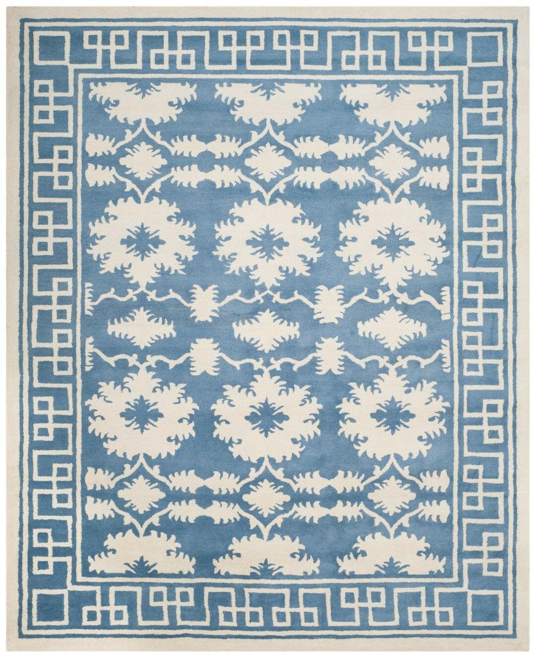 Amundson Hand Tufted Blue/Ivory Area Rug Rug Size: Rectangle 6' x 9'
