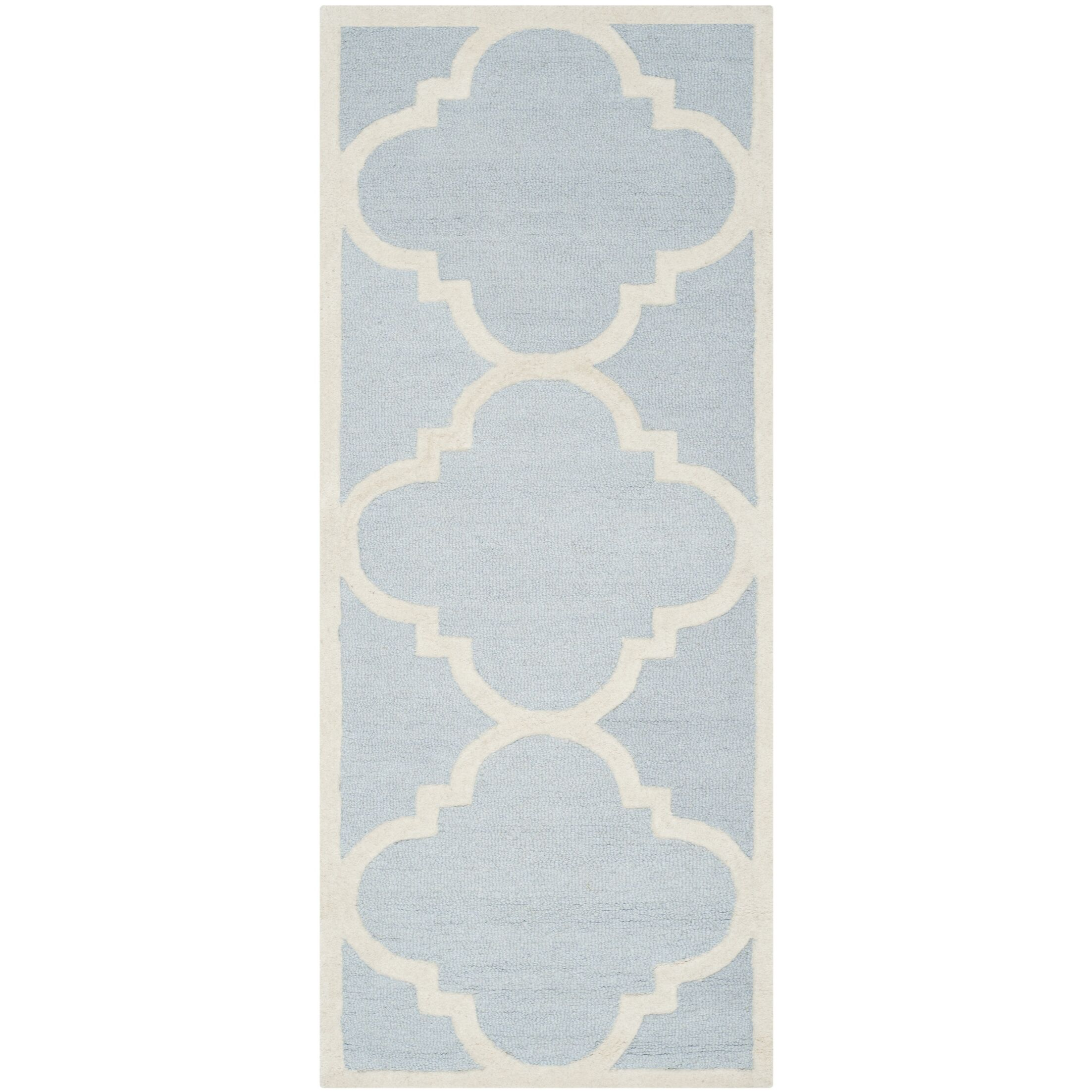 Bring classic style to your bedroom, living room, or home office with this richly-dimensional Charlenne Traditional Light Blue/Ivory Area Rug. Artfully tufted, these plush wool area rugs are crafted with plush and loop textures to highlight timeless m...