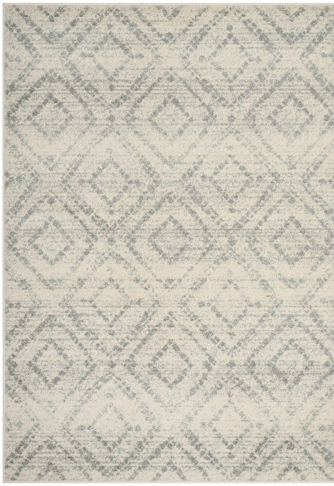 Buckleton Ivory/Light Blue Area Rug Rug Size: Rectangle 6' x 9'