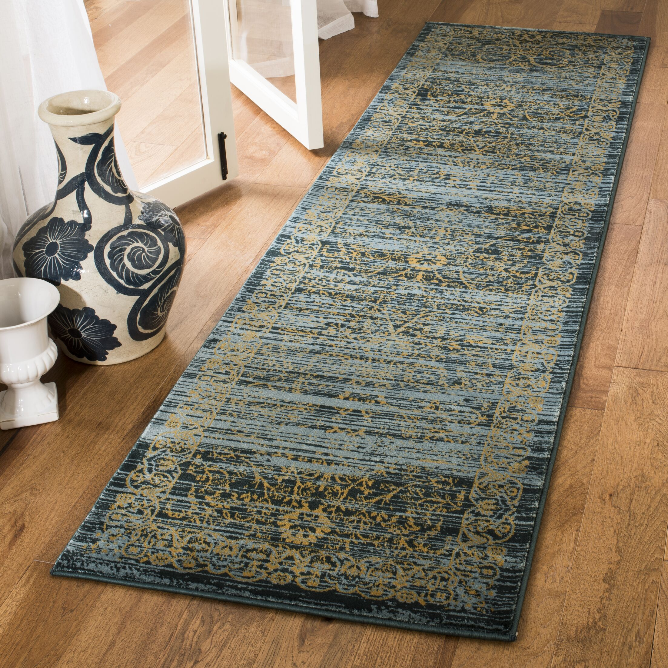Zennia Turquoise & Gold Area Rug Rug Size: Runner 2'3
