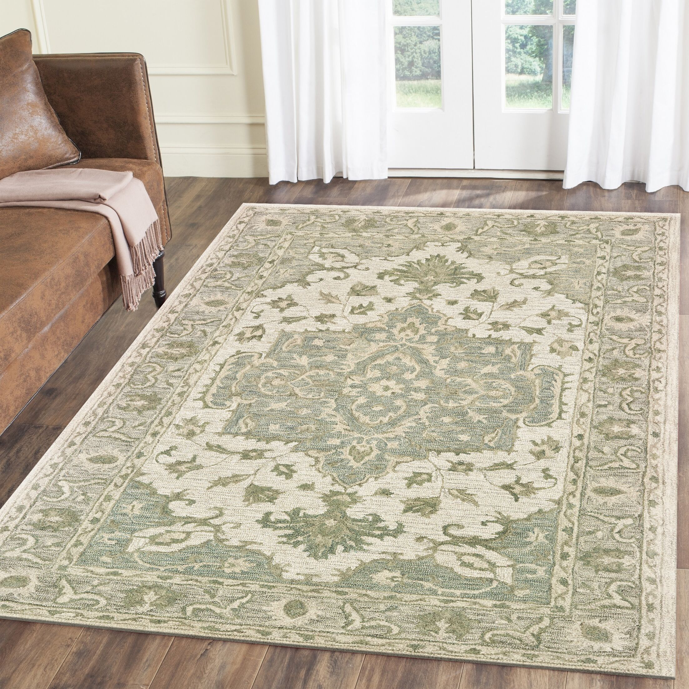 Deol Hand-Tufted Wool Teal Area Rug Rug Size: Rectangle 5' x 7'9