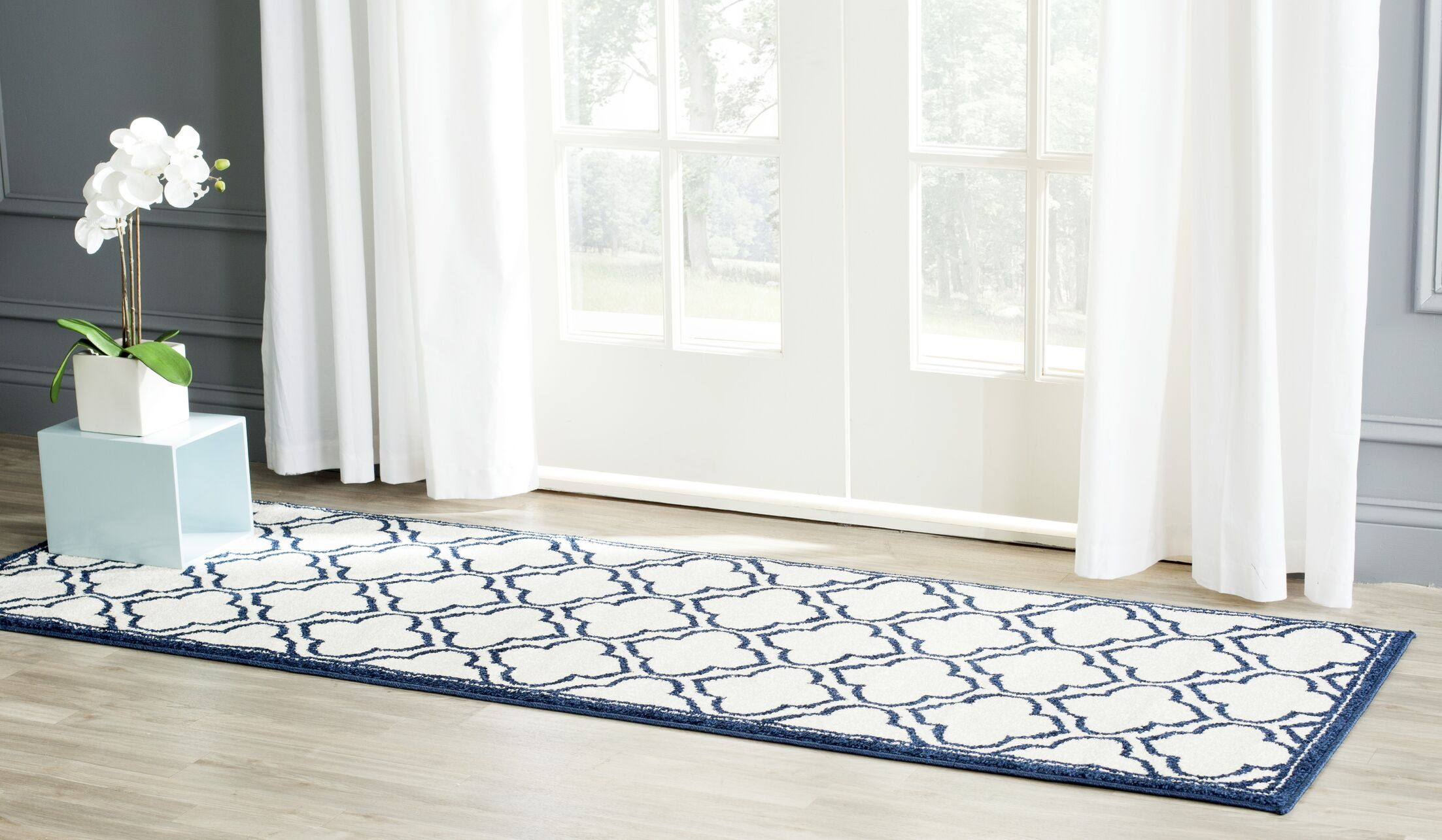 Maritza Traditional Ivory/Navy Indoor/Outdoor Area Rug Rug Size: Runner 2'3