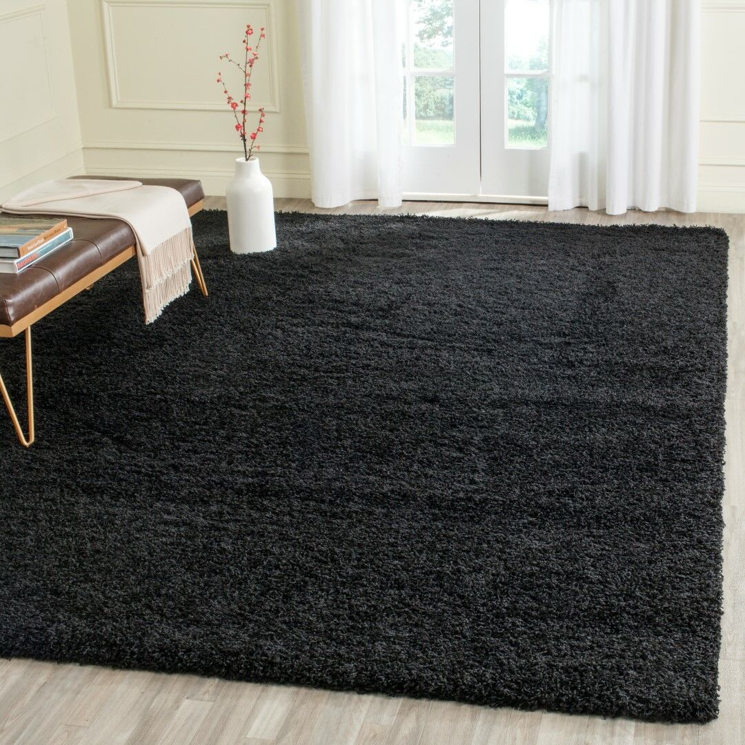 Beldon Power Loom Black Area Rug Rug Size: Rectangle 6'7
