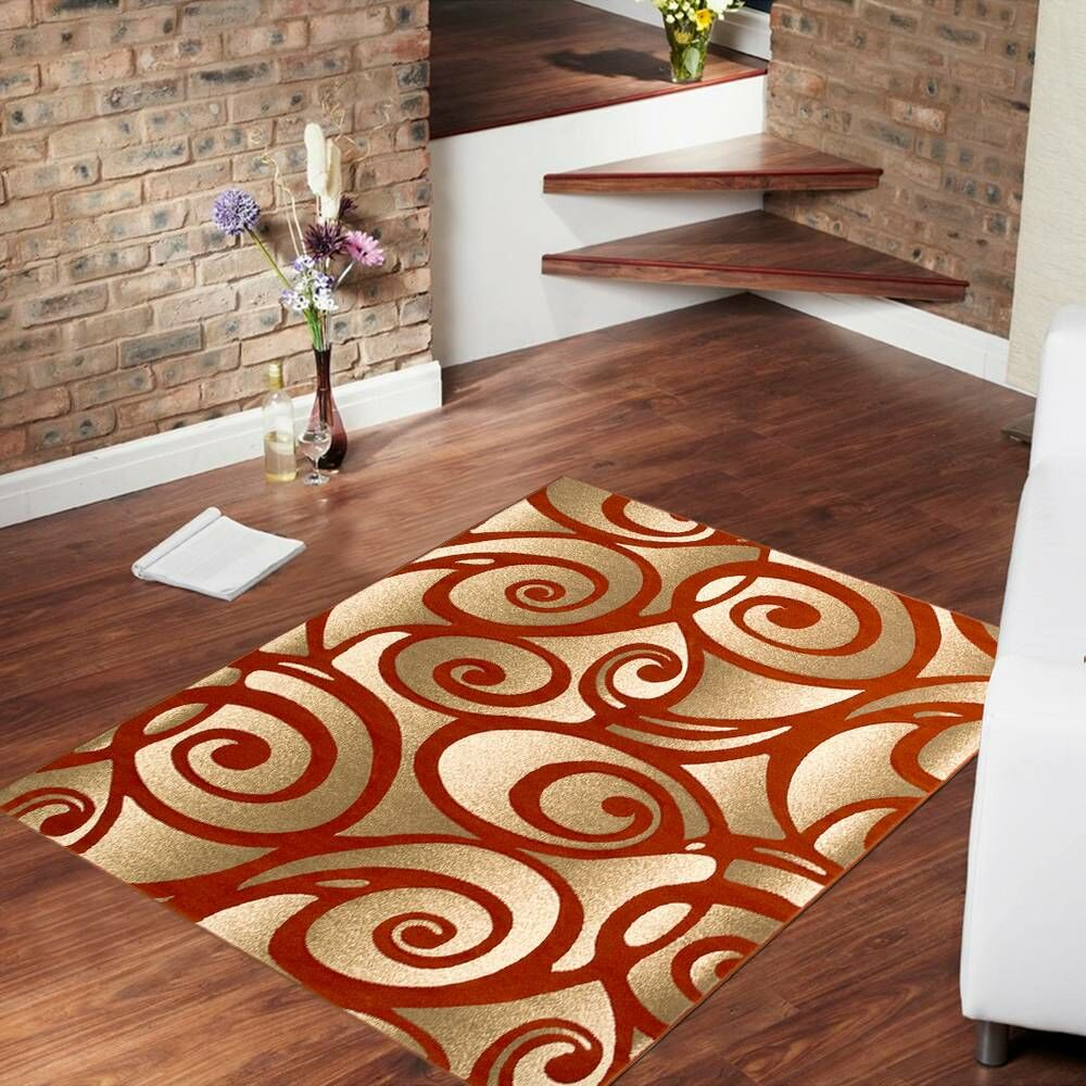 Evolution Swirl Rust/Gold Area Rug Rug Size: Rectangle 7'9