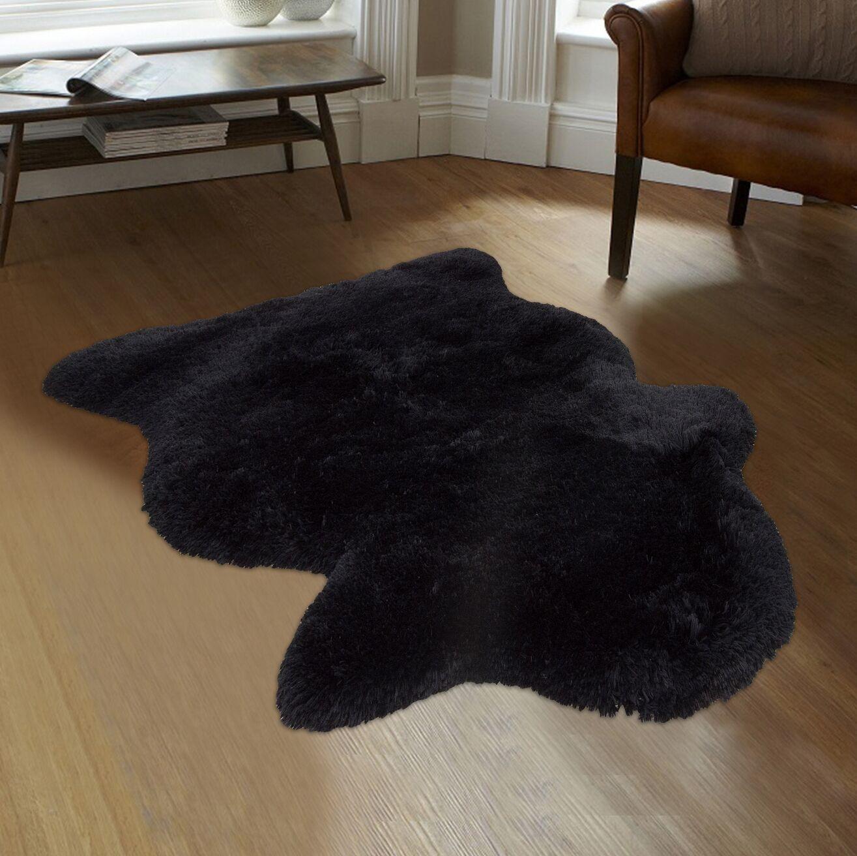 Faux Sheepskin Black Area Rug Rug Size: 7'6