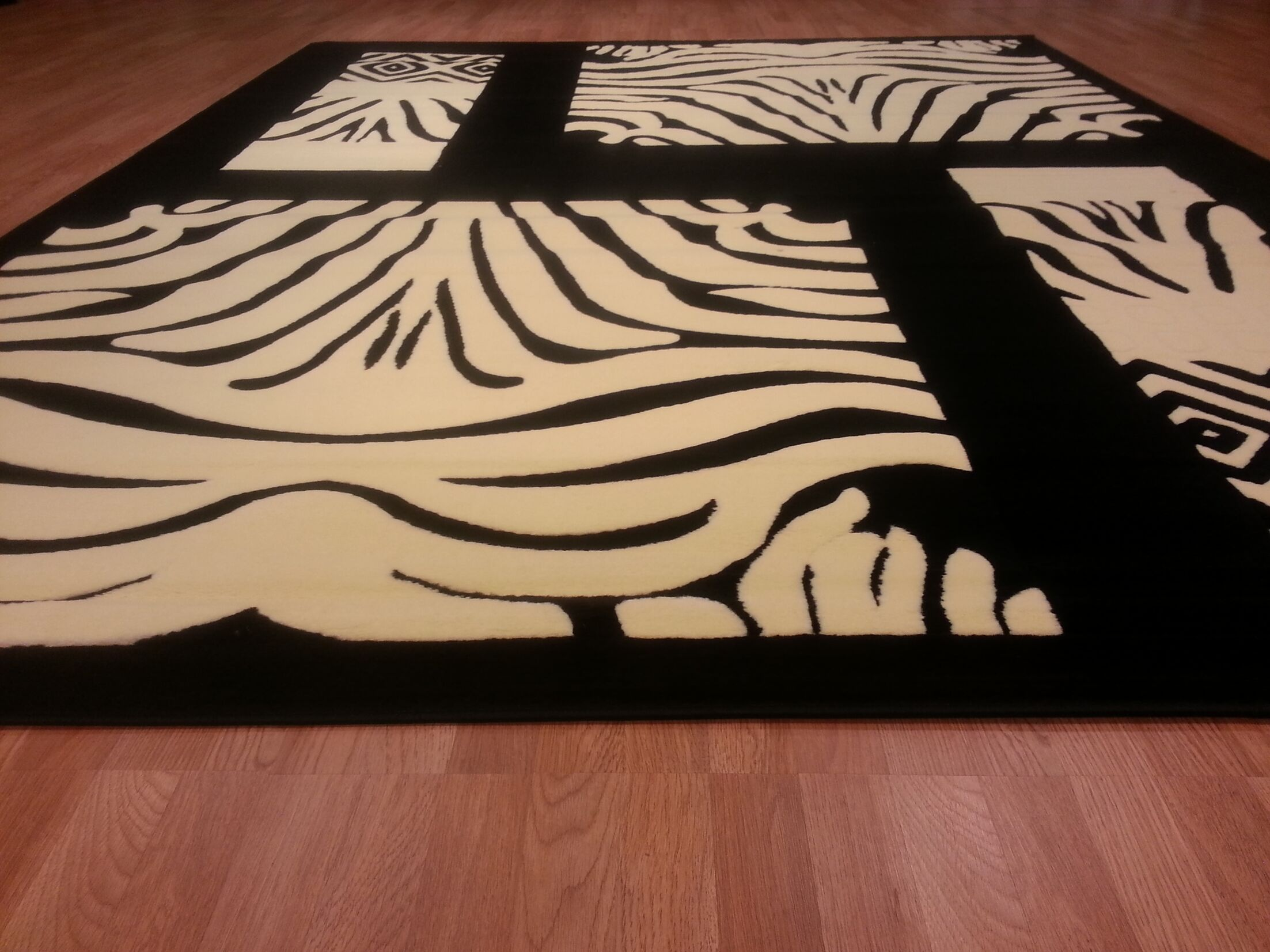 Hand-Carved Black / White Area Rug Rug Size: Rectangle 7'11