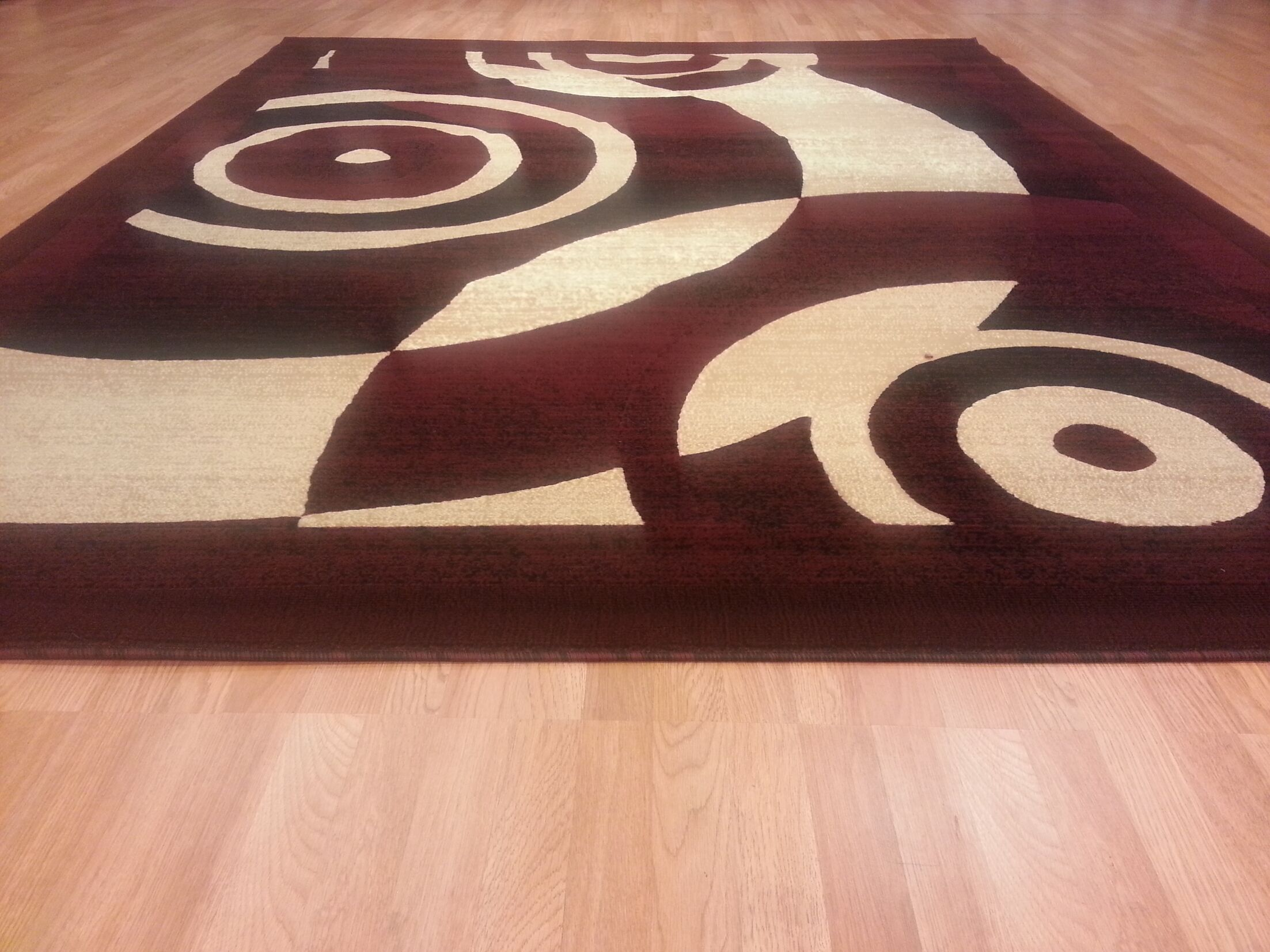 Hand-Carved Red Area Rug Rug Size: Rectangle 7'11