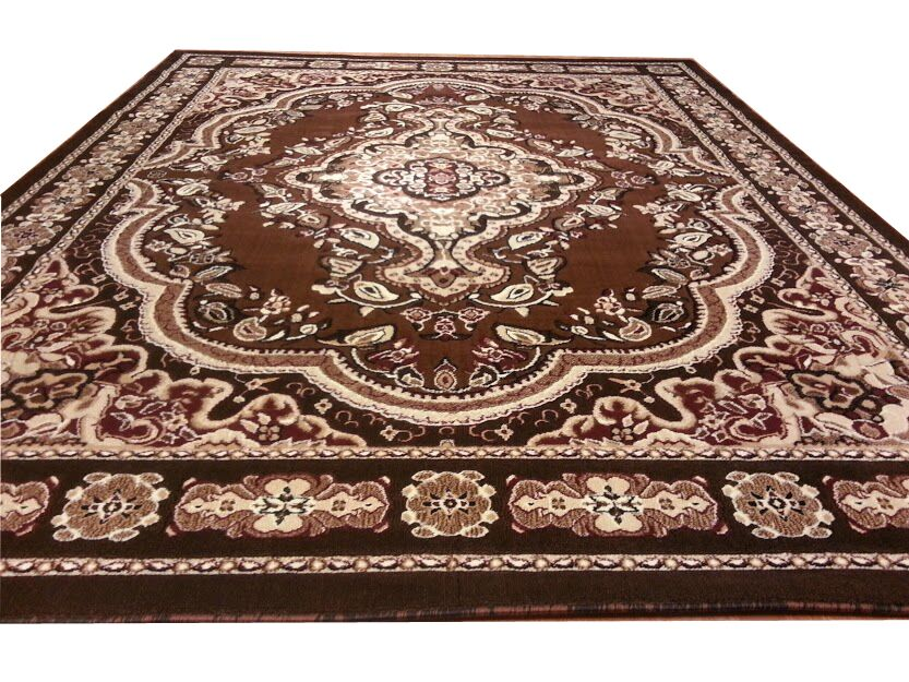 Hand-Carved Brown Area Rug Rug Size: Rectangle 5'3