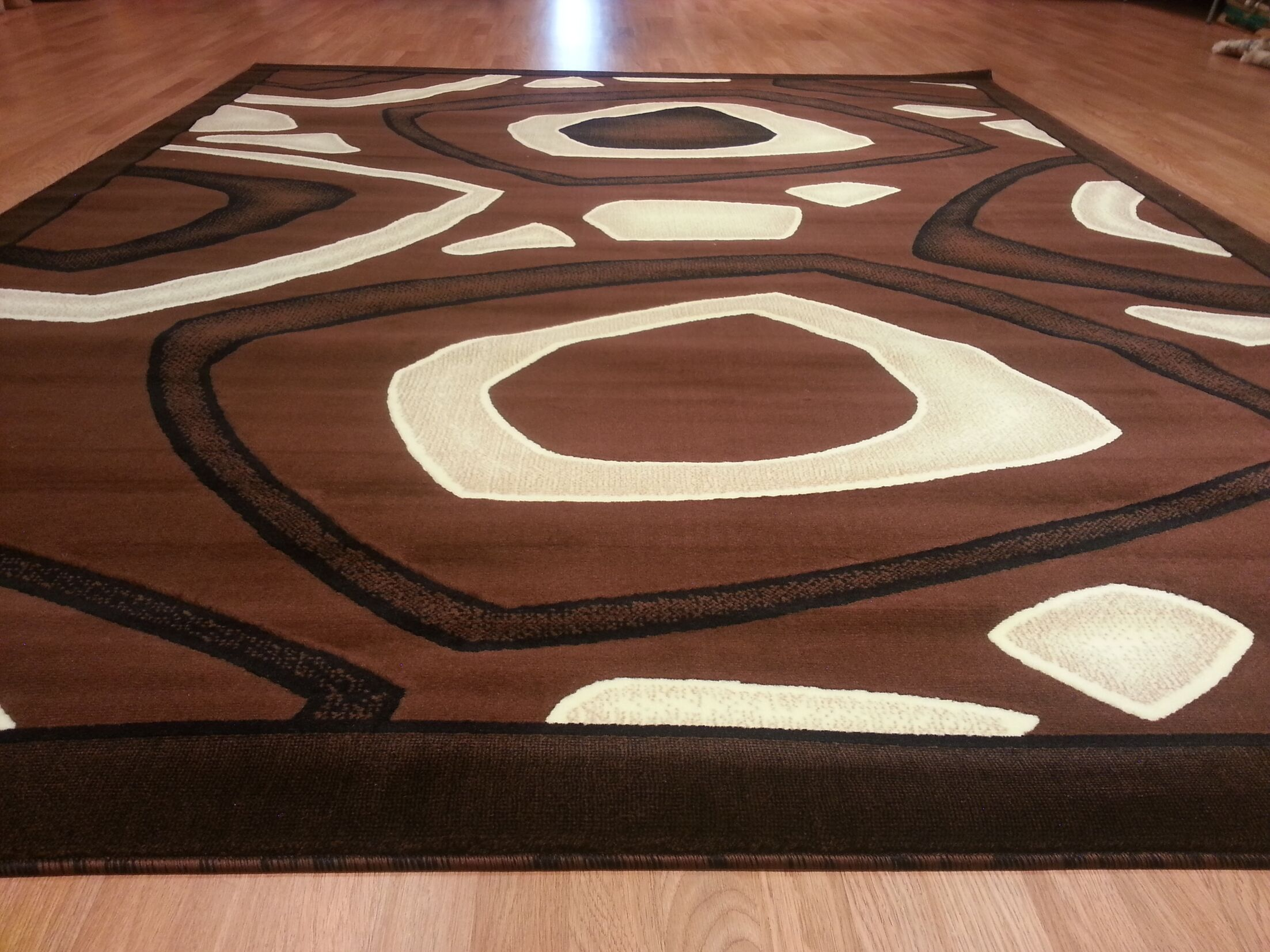 Hand-Carved Brown Area Rug Rug Size: Rectangle 4' x 6'