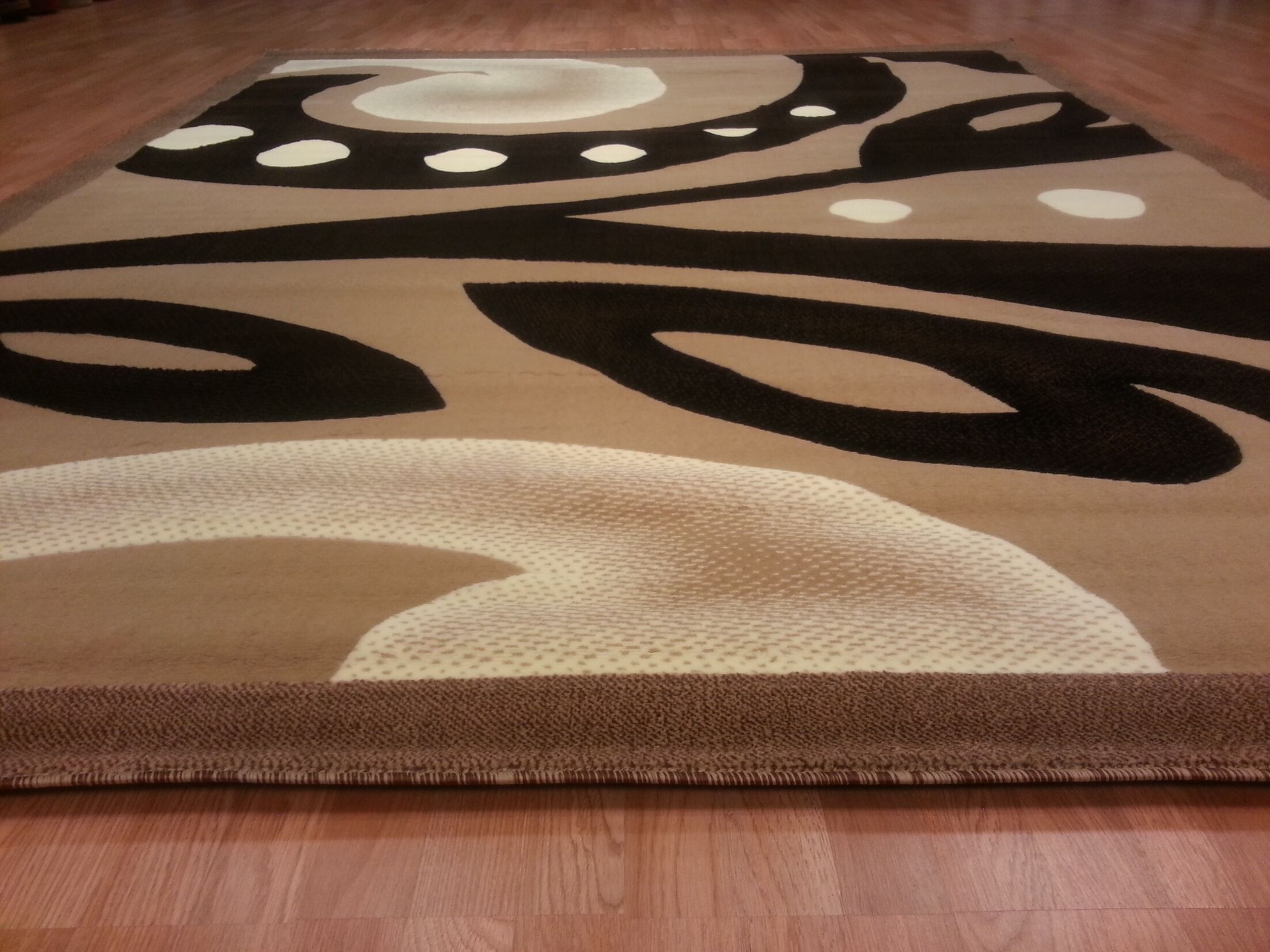 Hand-Carved Brown/Black Area Rug Rug Size: Rectangle 7'11