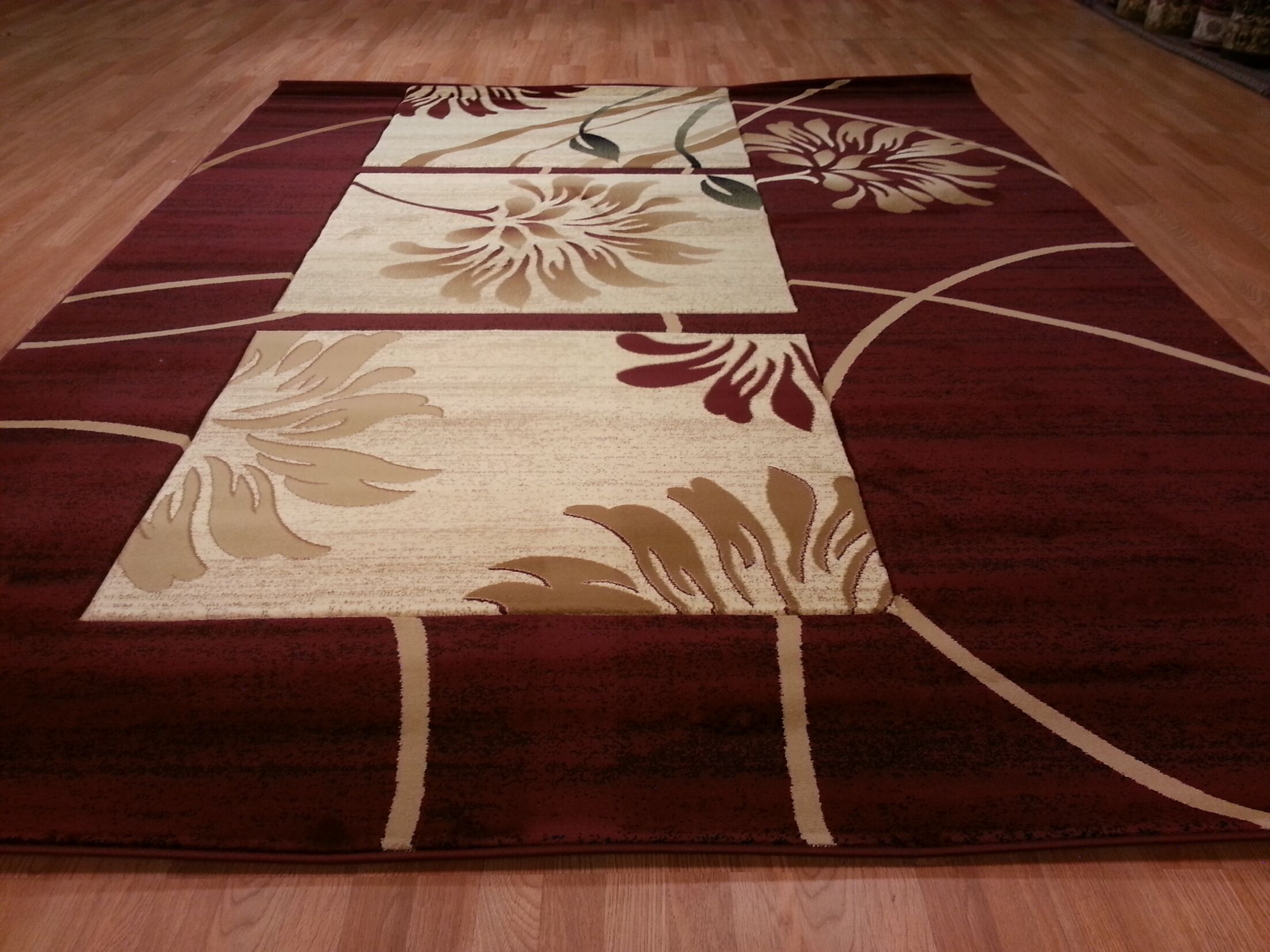 Hand-Carved Red Area Rug Rug Size: Rectangle 5'3
