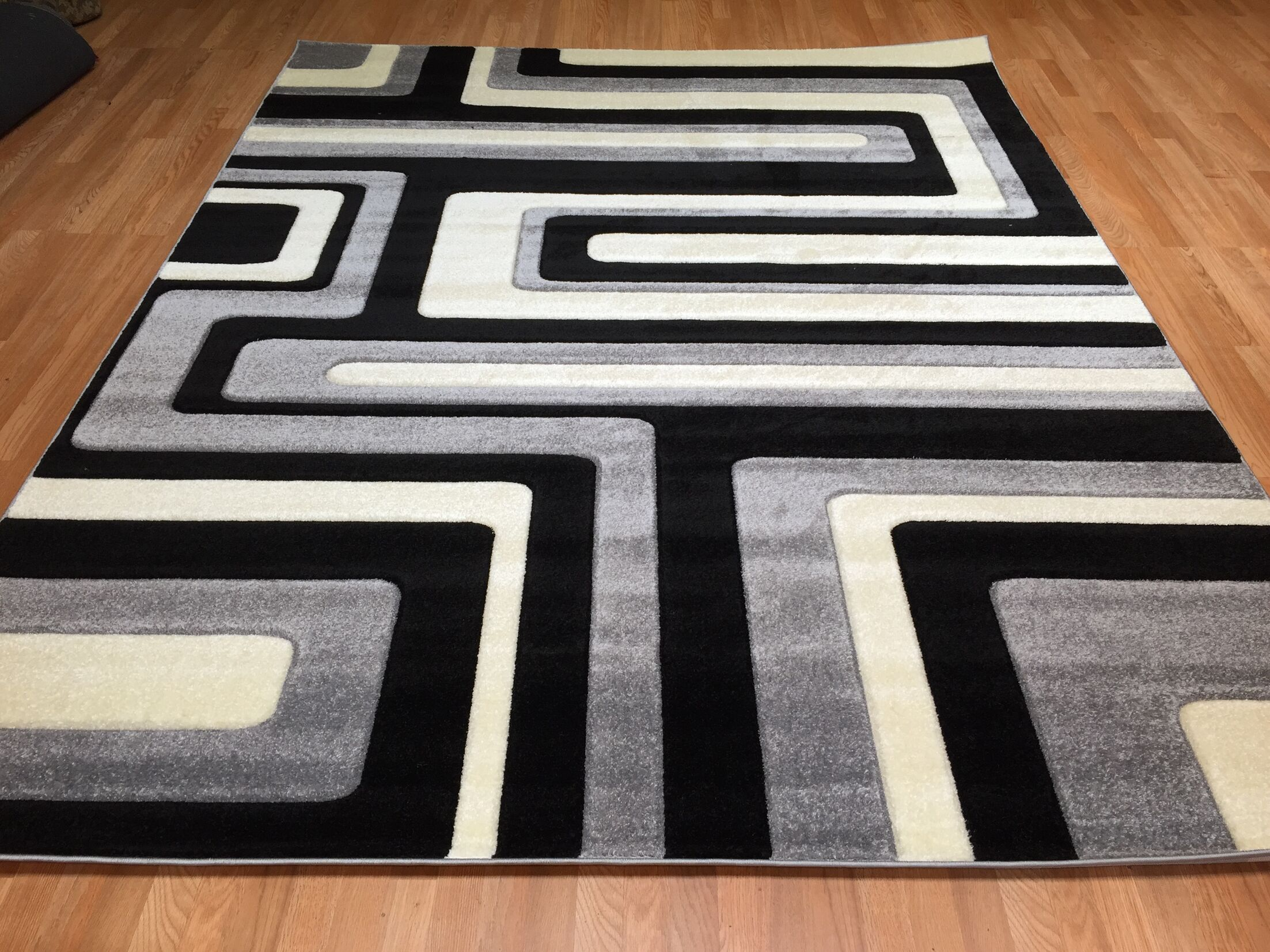 Hand-Carved Black/Gray Area Rug Rug Size: 5'3