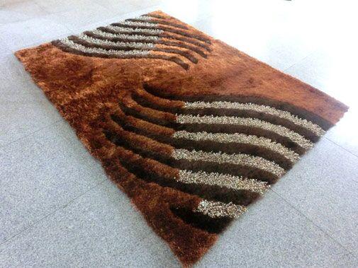 Kayonda Brown Area Rug Rug Size: 7' x 10'