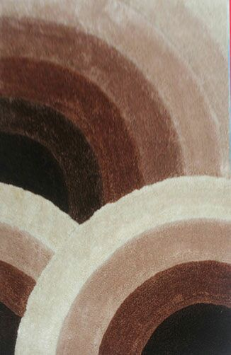 Sadik Brown Area Rug Rug Size: 6'6