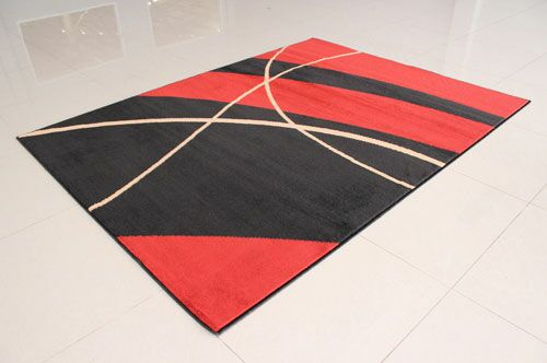 Black/Orange Area Rug Rug Size: 7'11