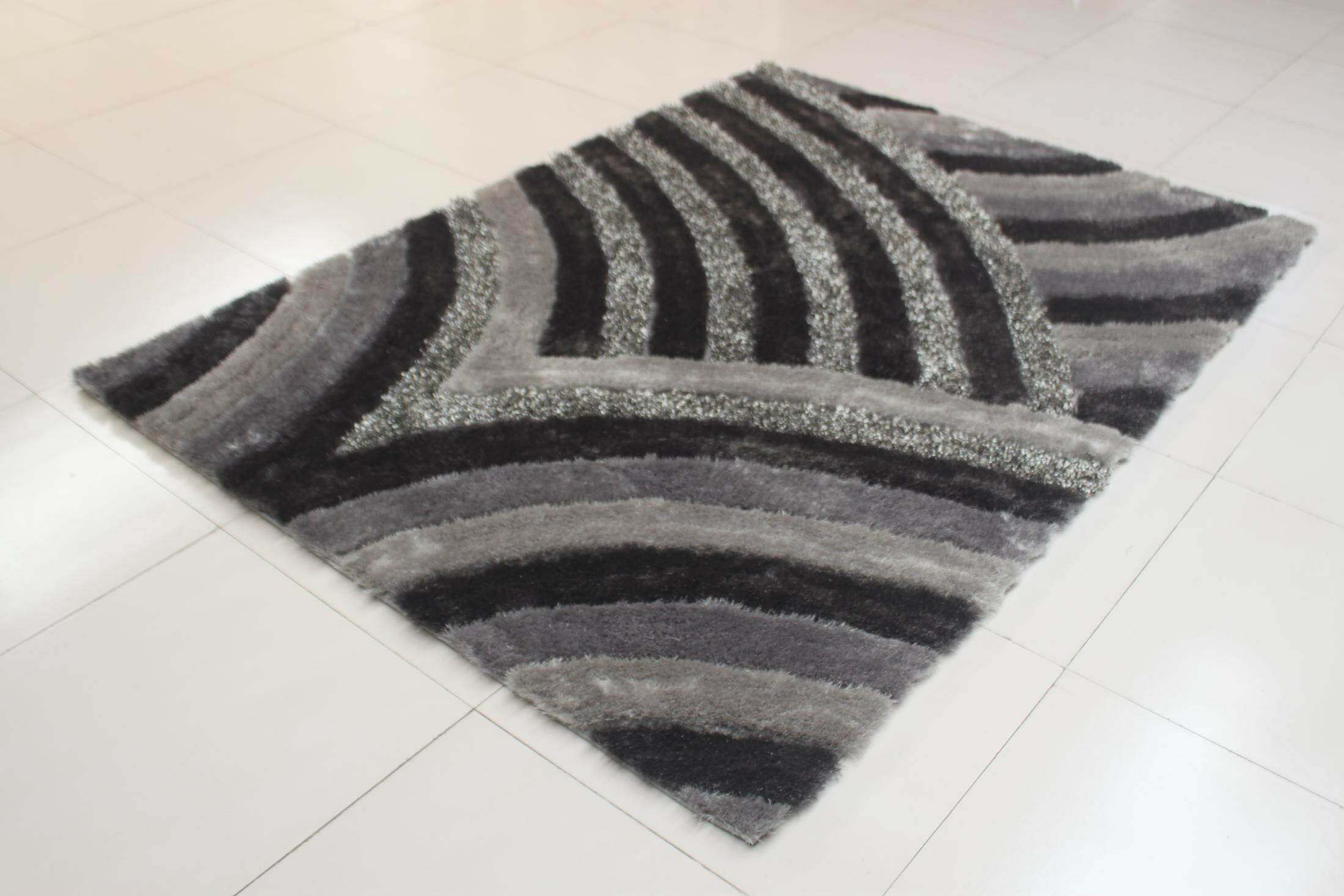 Joshawn Wave Pattern Gray Area Rug Rug Size: 7'11