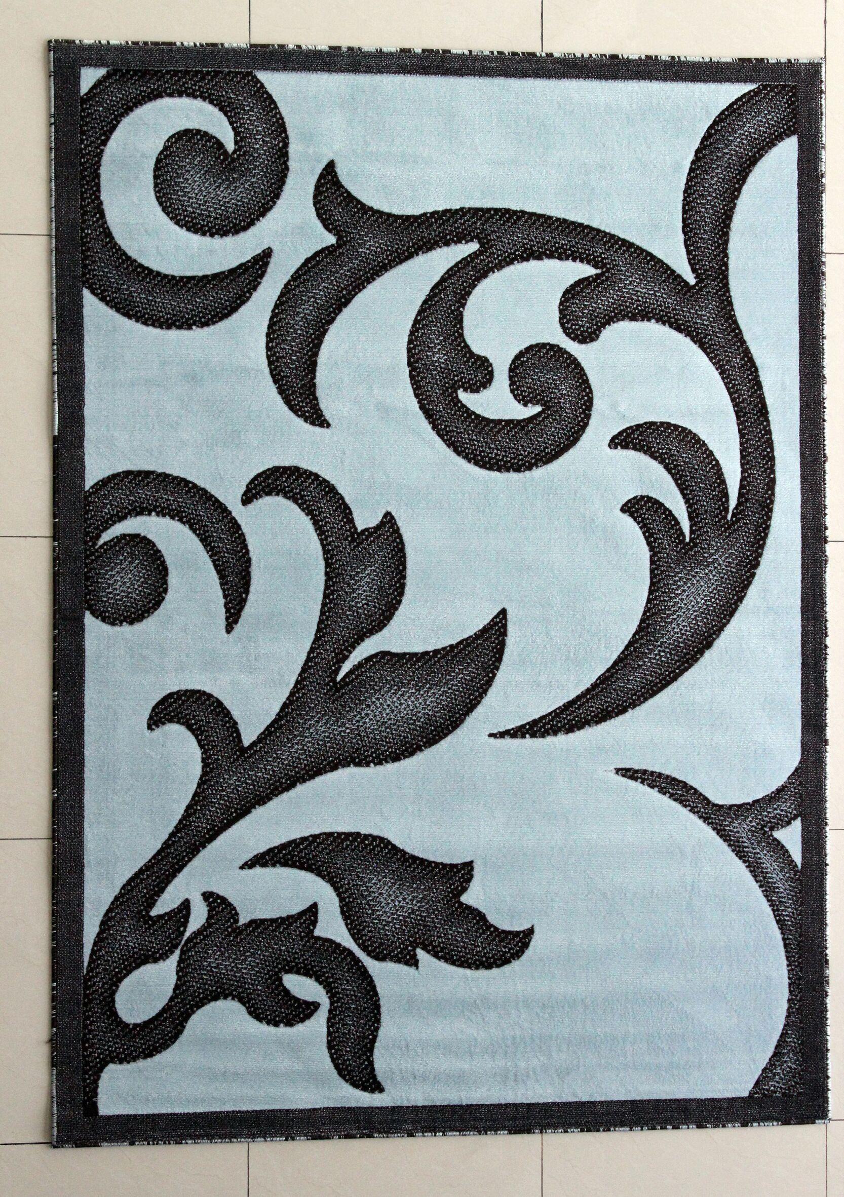 Lucinda Dark Blue Area Rug Rug Size: 7'11