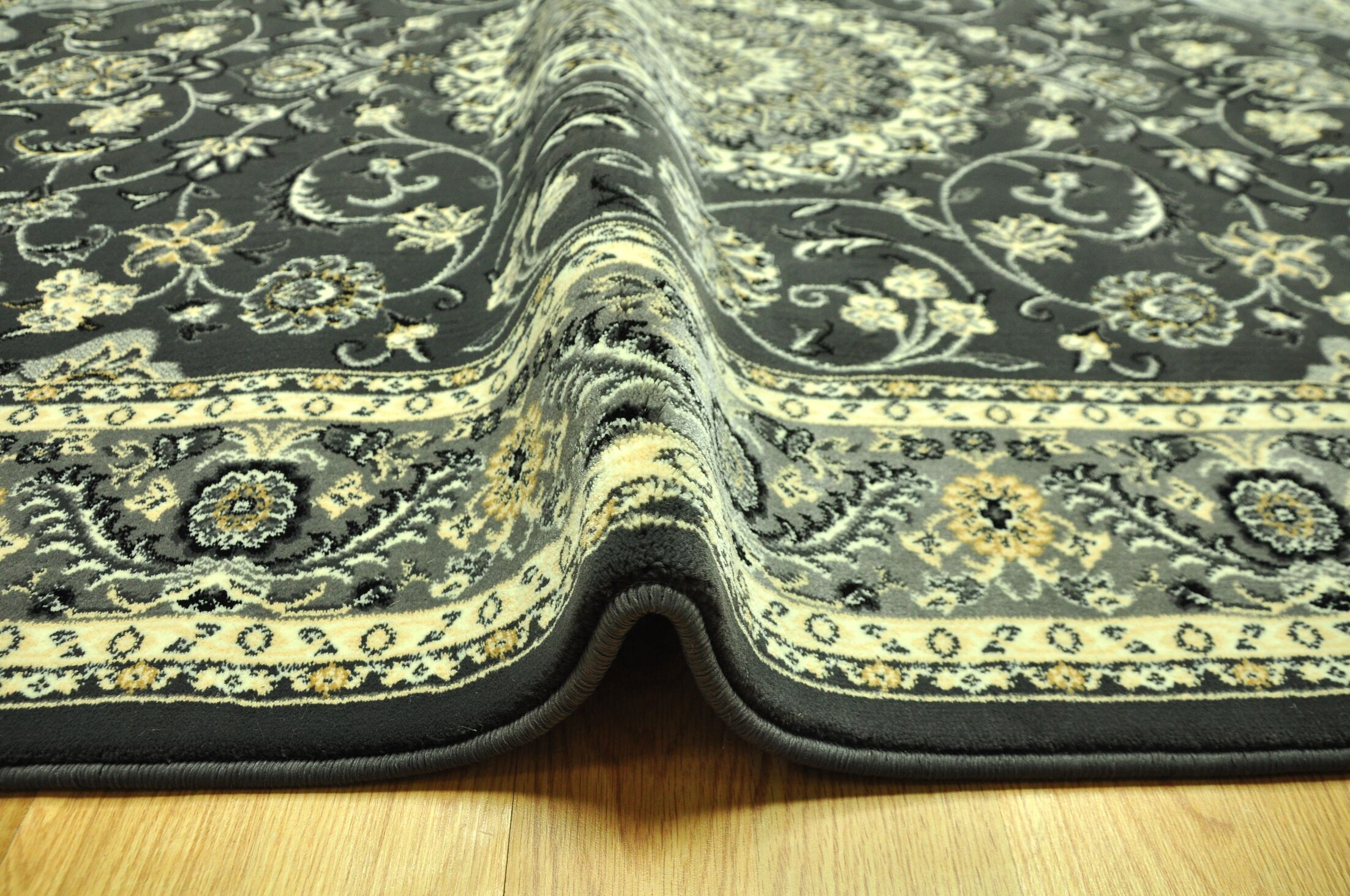 Zoelle Traditional Black/Ivory Area Rug Rug Size: Runner 2'7