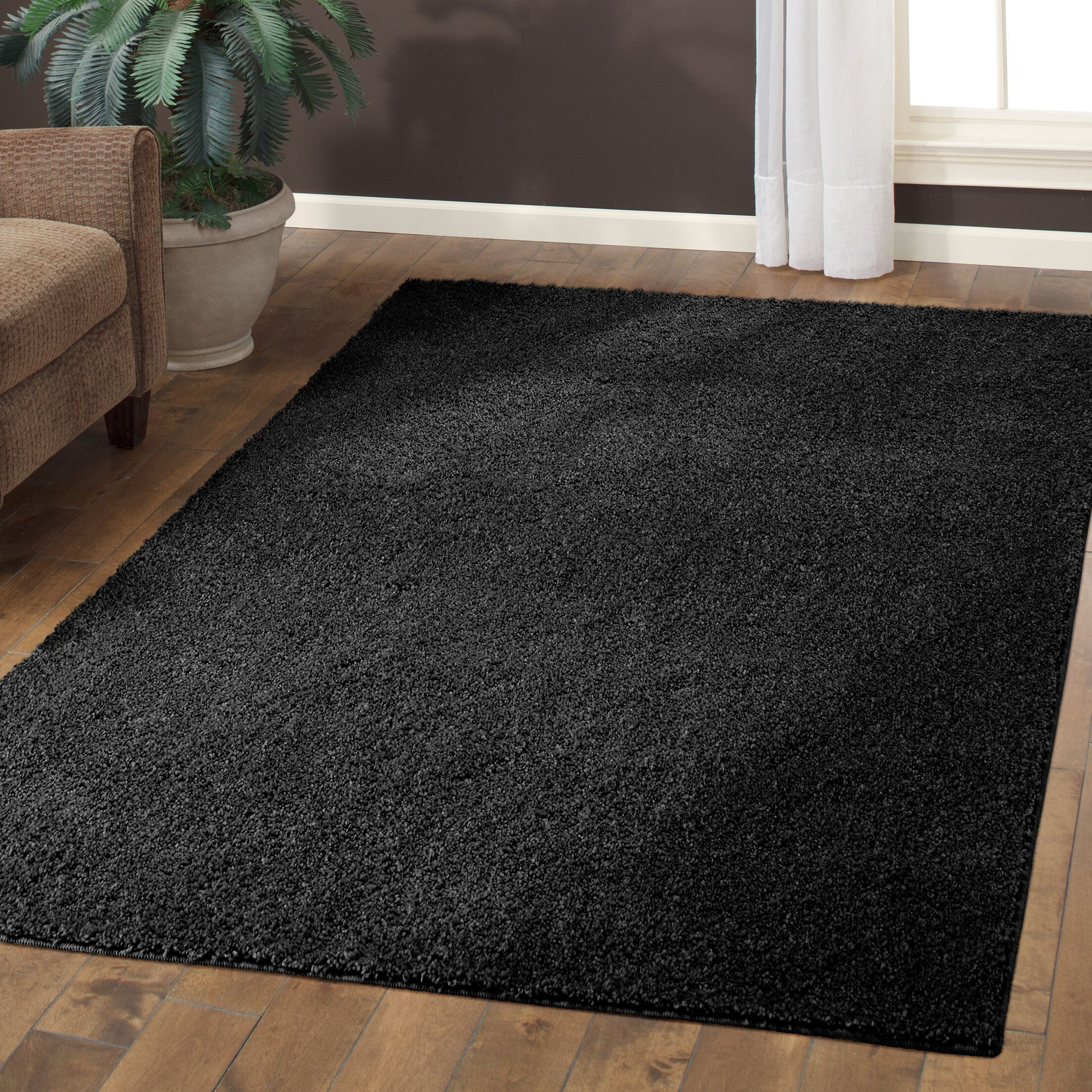 Aviles Black Area Rug Rug Size: 7' x 10'