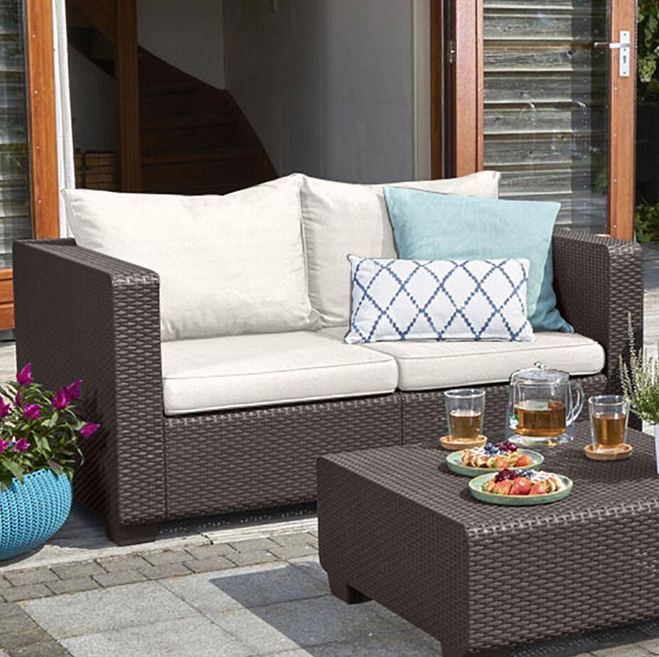 Halloran Loveseat with Sunbrella Cushions Frame Color: Brown