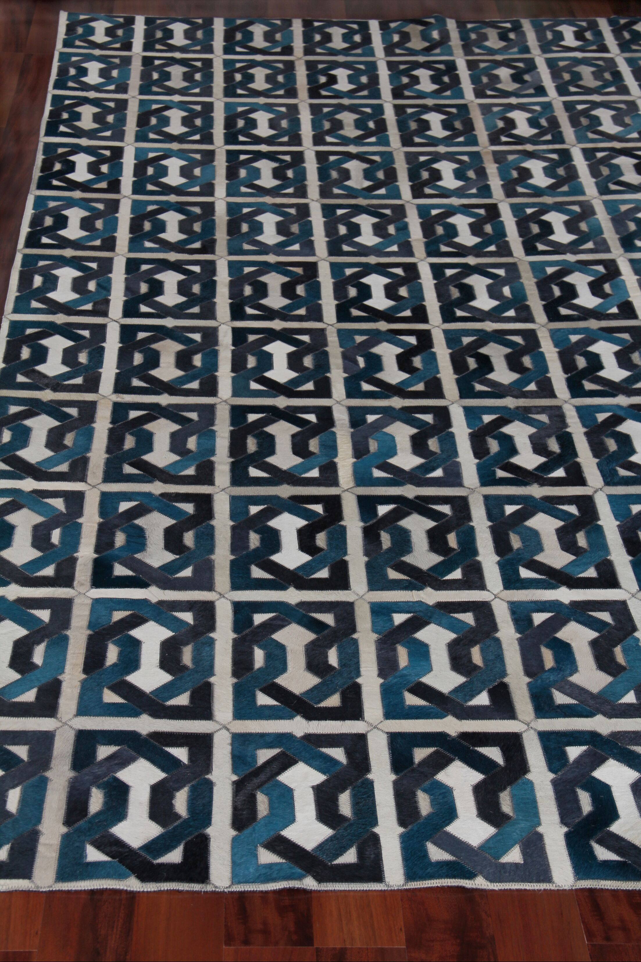 Natural Hide Leather Hand-Woven Teal/Black Area Rug Rug Size: Rectangle 5' x 8'