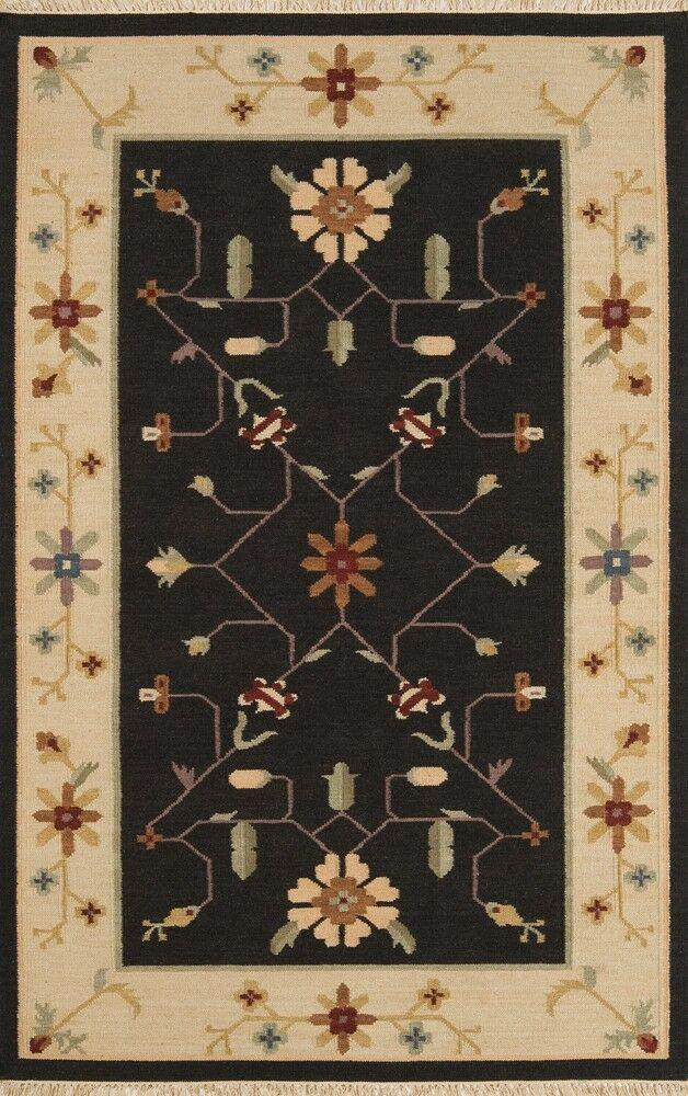 JiJum Black Border Hand Knotted Wool Area Rug Rug Size: Rectangle 8' x 11'