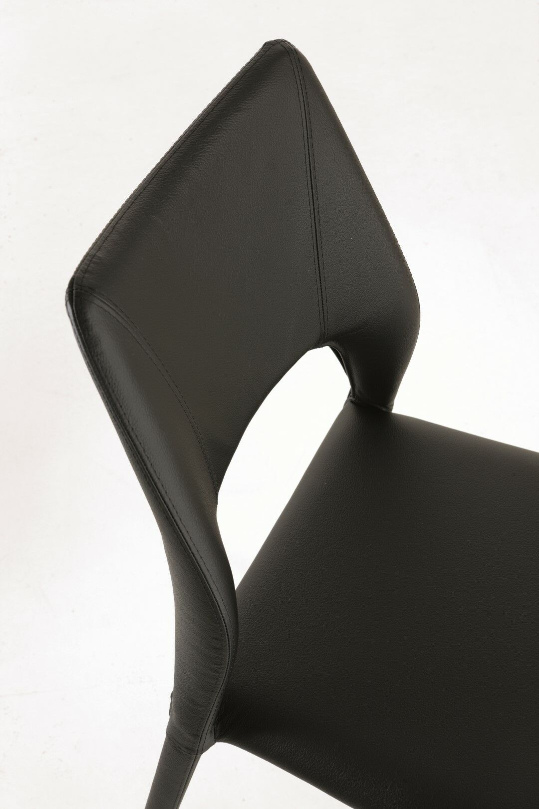 Juno Genuine Leather Upholstered Dining Chair Color: Black