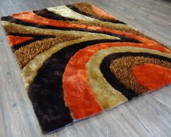 Ozment Shaggy Hand-Tufted Brown/Orange Area Rug