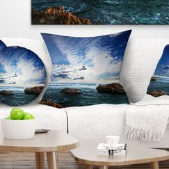 Rocky Beach with Clouds Pillow Size: 18